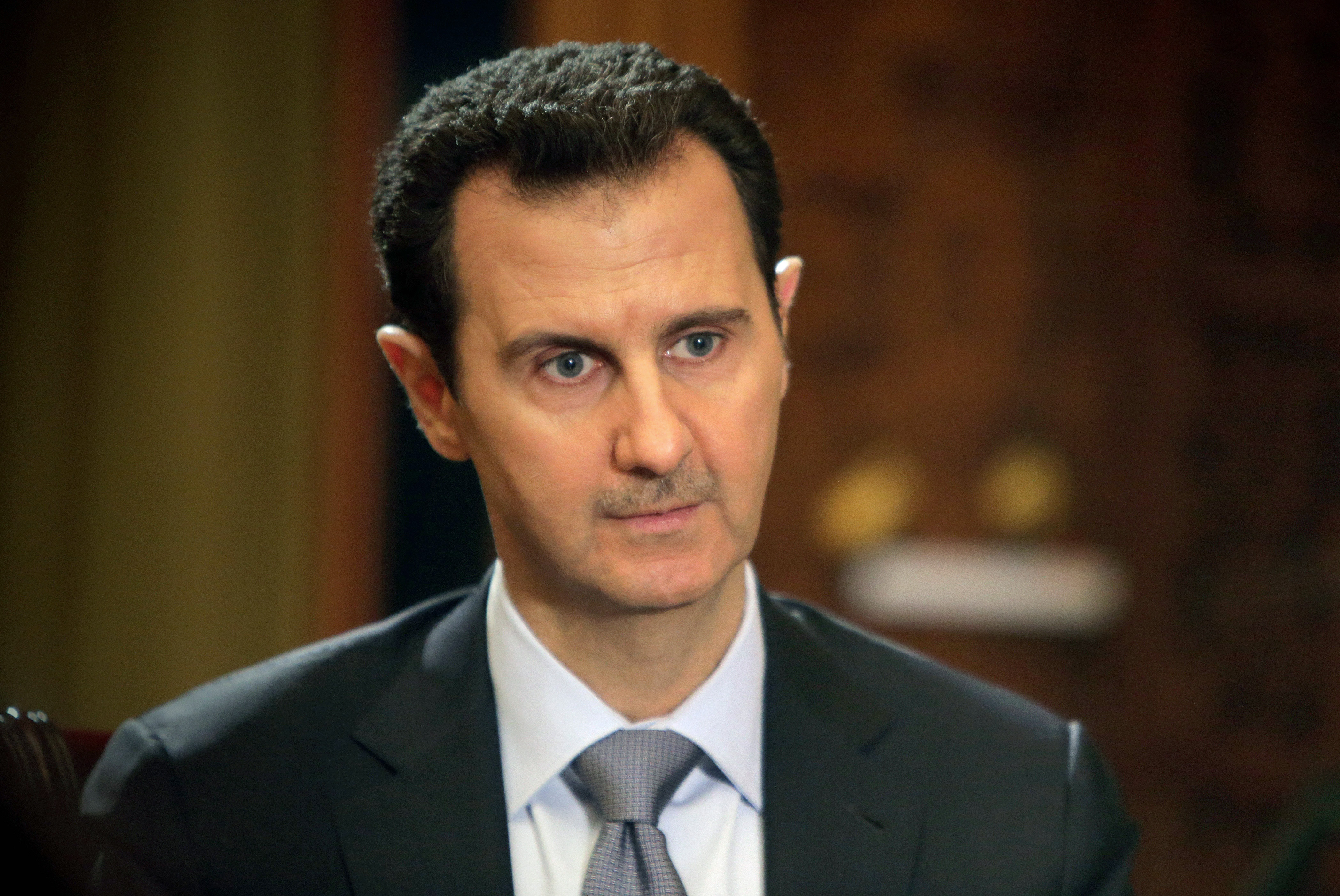 Syrian President Bashar al-Assad gives an interview to AFP at the presidential palace in Damascus on Jan. 20, 2014.