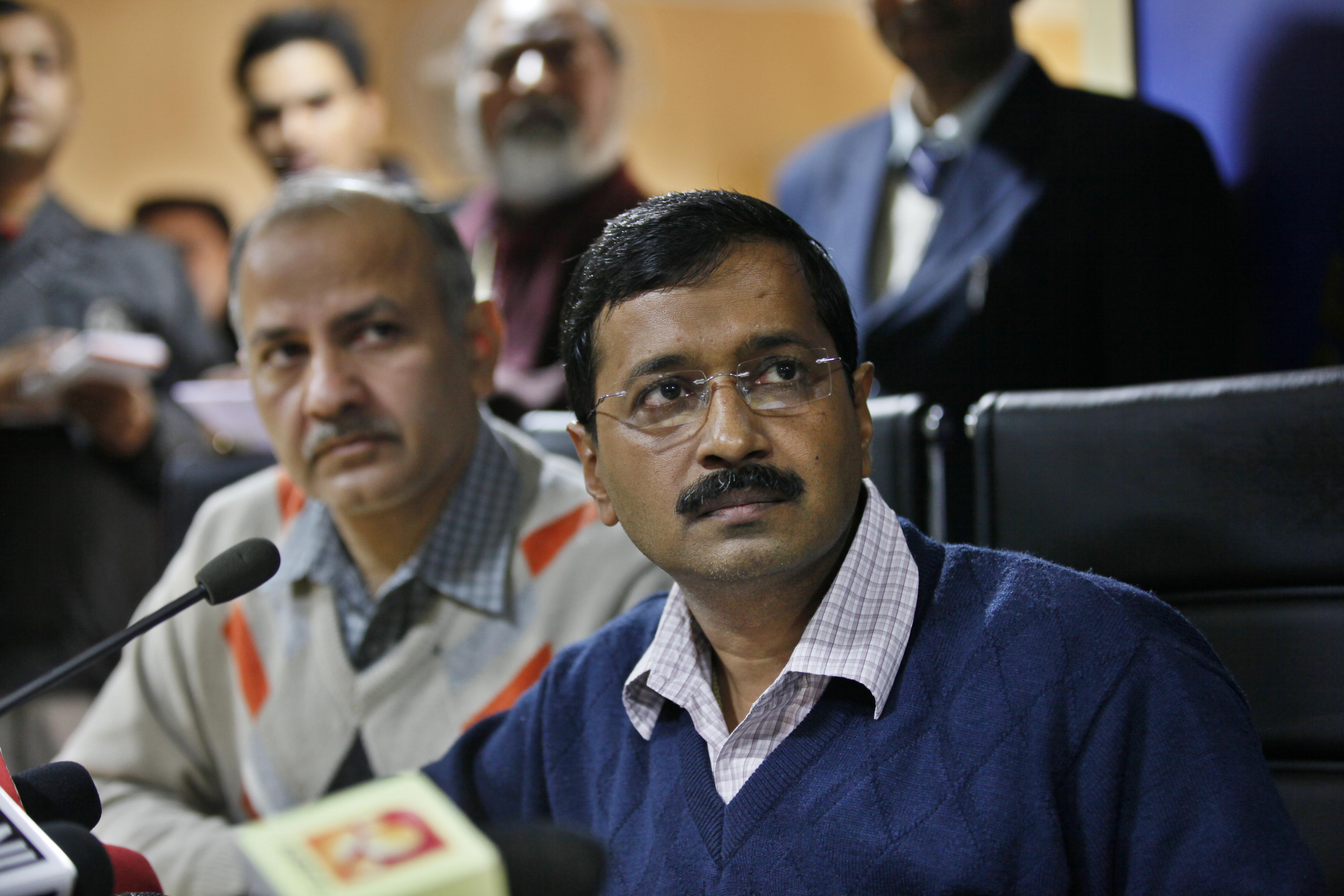From right: Delhi Chief Minister Arvind Kejriwal and Manish Sisodia address a news conference on Feb. 11, 2014 in New Delhi.