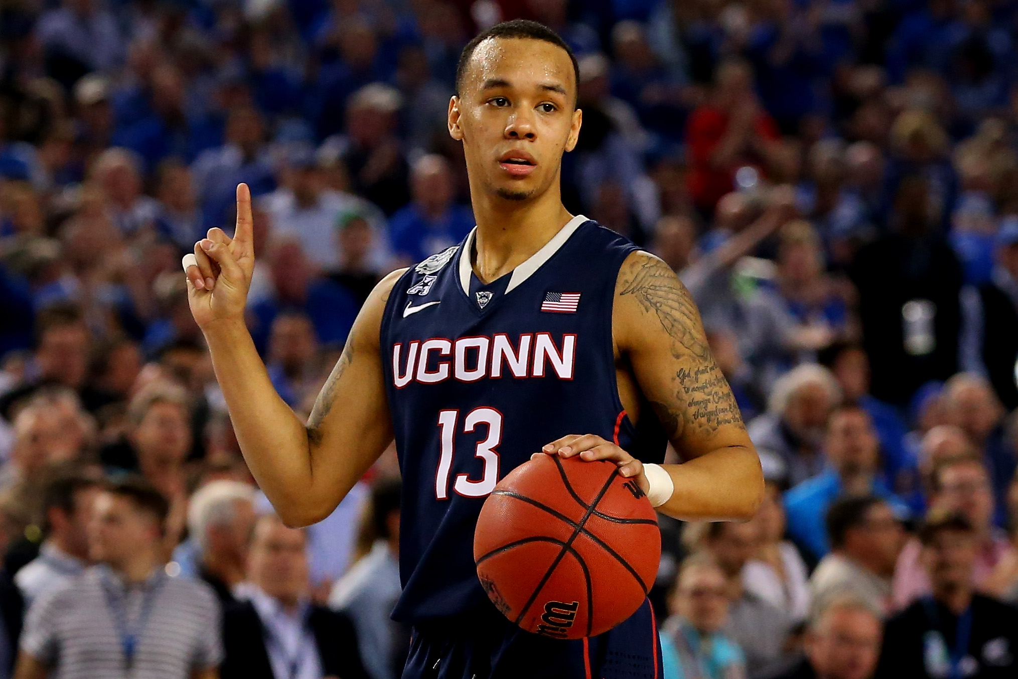 Shabazz Napier of the Connecticut Huskies reacts during the NCAA Men's Final Four Semifinal against the Florida Gators at AT&T Stadium on April 5, 2014 in Arlington, Texas.