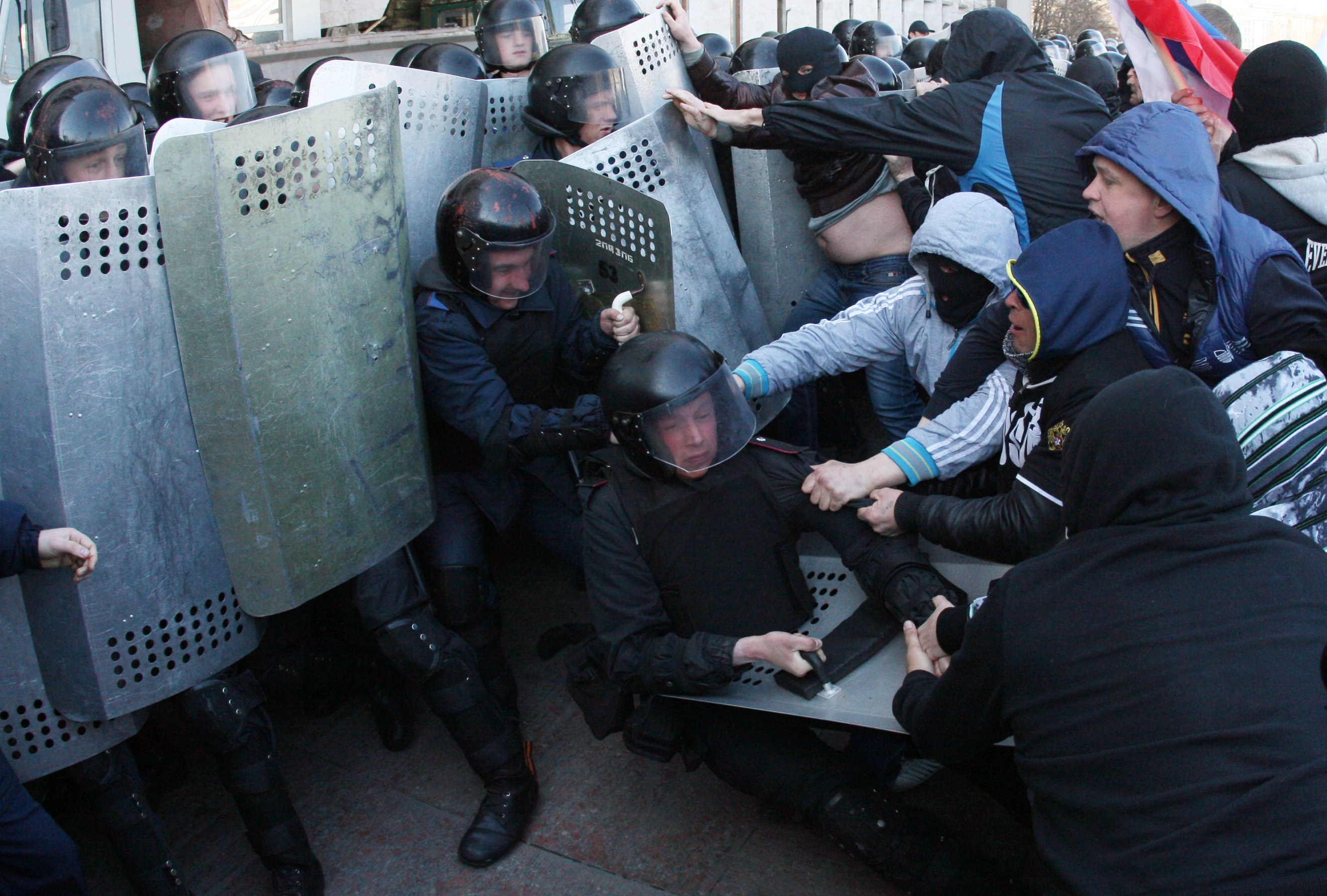 Pro-Russian supporters clash with members of the riot police as they storm the regional administration building in Donetsk, Ukraine, on April 6, 2014