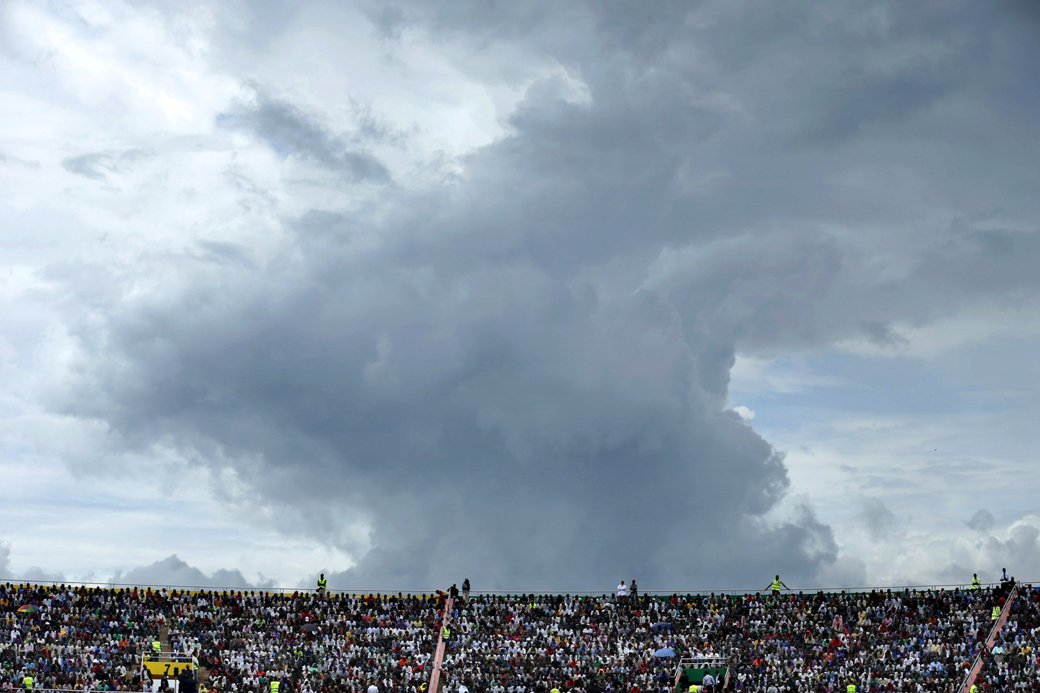 Apr. 7, 2014. The sky threatens rain as tens of thousands of people gather to commemorate the 20th anniversary the 1994 genocide at Amahoro Stadium  in Kigali, Rwanda.