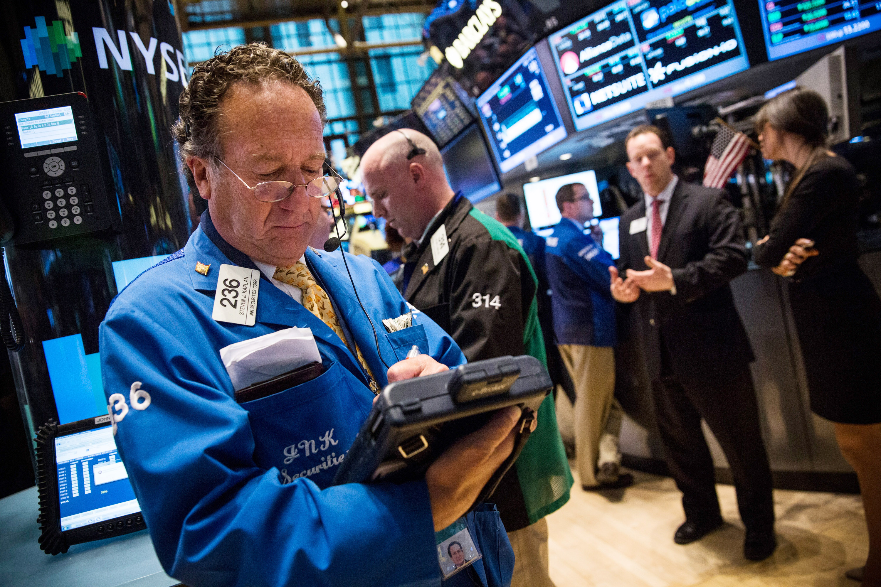 A trader works on the floor of the New York Stock Exchange during the afternoon of April 7, 2014 in New York City.