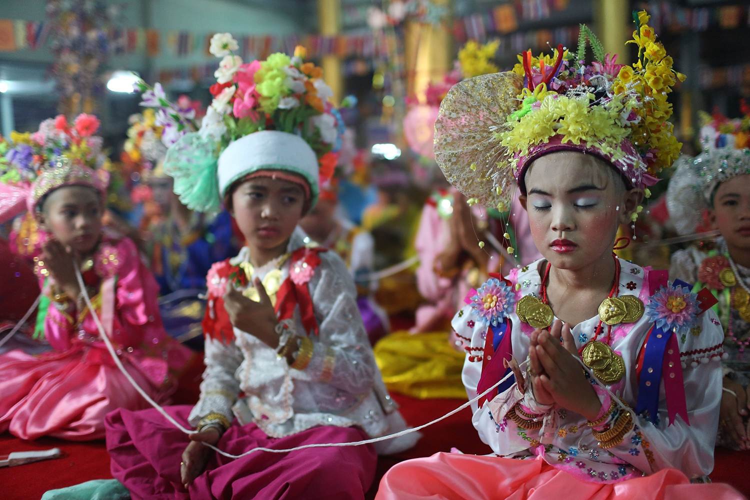 Apr. 8, 2014. A Tai Yai boy prays during a ceremony in Mae Hong Son, Thailand. Poy Sang Long is a Buddhist novice ordination ceremony of the Shan people or Tai Yai.