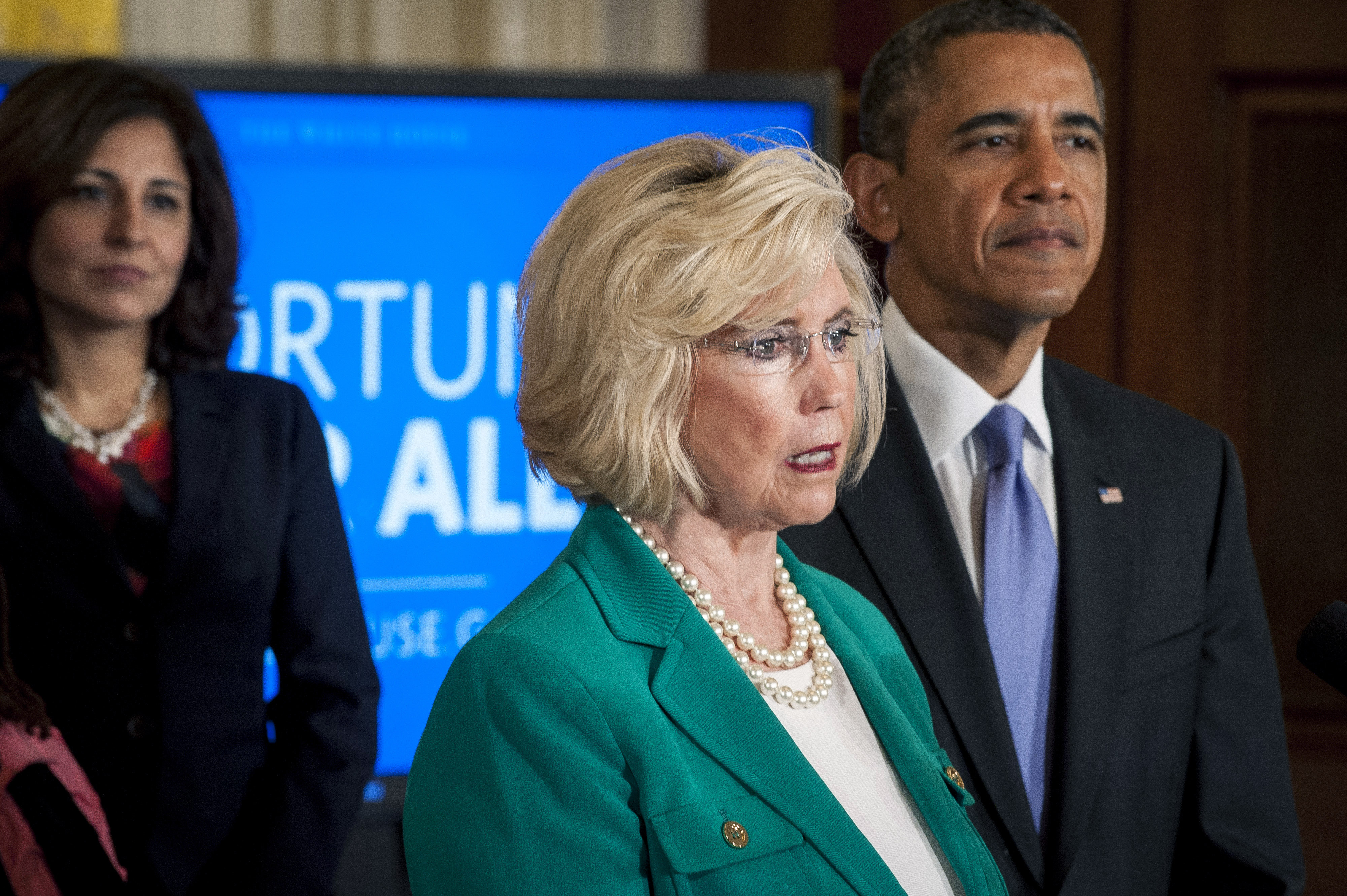 President Barack Obama looks on as pay discrimination victim Lilly Ledbetter delivers remarks at an event  marking Equal Pay Day in the East Room of the White House in Washington, D.C., U.S., on Tuesday, April 8, 2014.