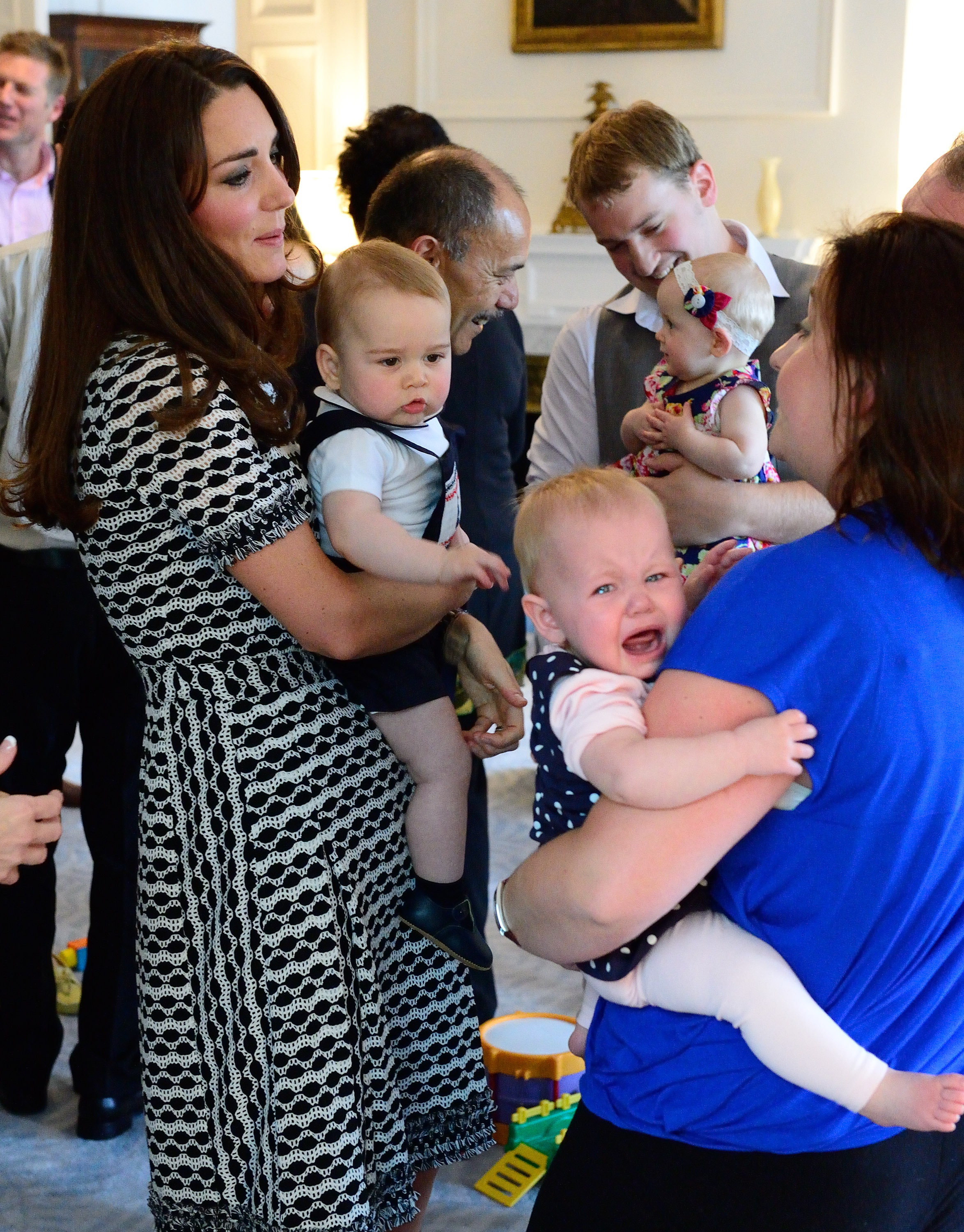 The Duke and Duchess of Cambridge and Prince George attend an event at Government House in Wellington, New Zealand, on the 9th April 2014.