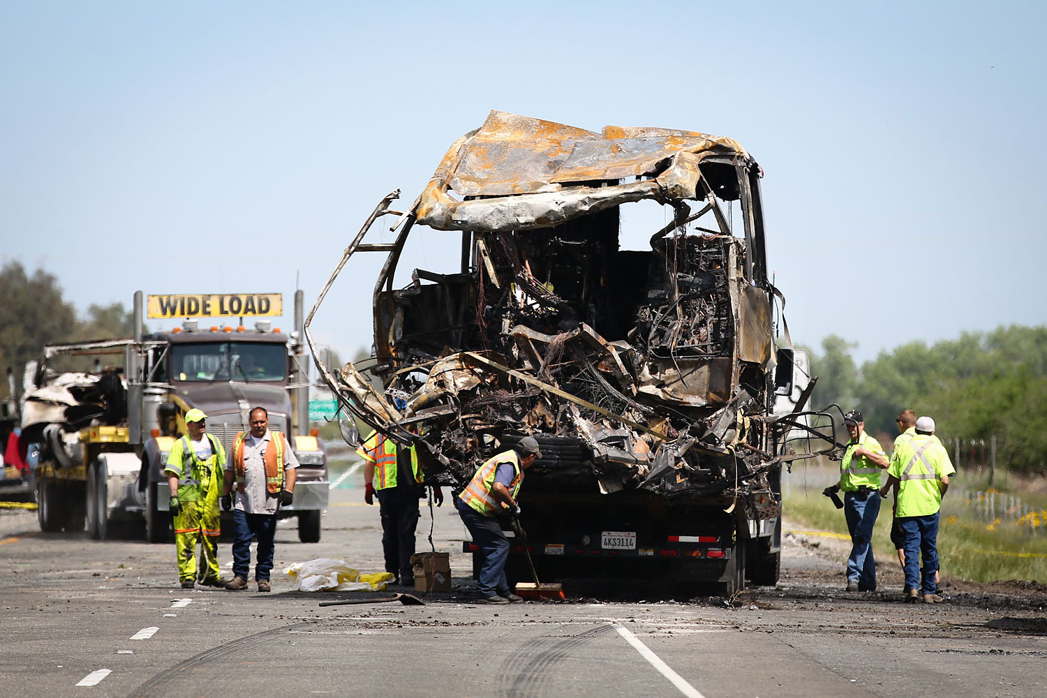 A bus involved in the deadly crash is loaded on to a truck at the scene on April 11, 2014  in Orland, California.