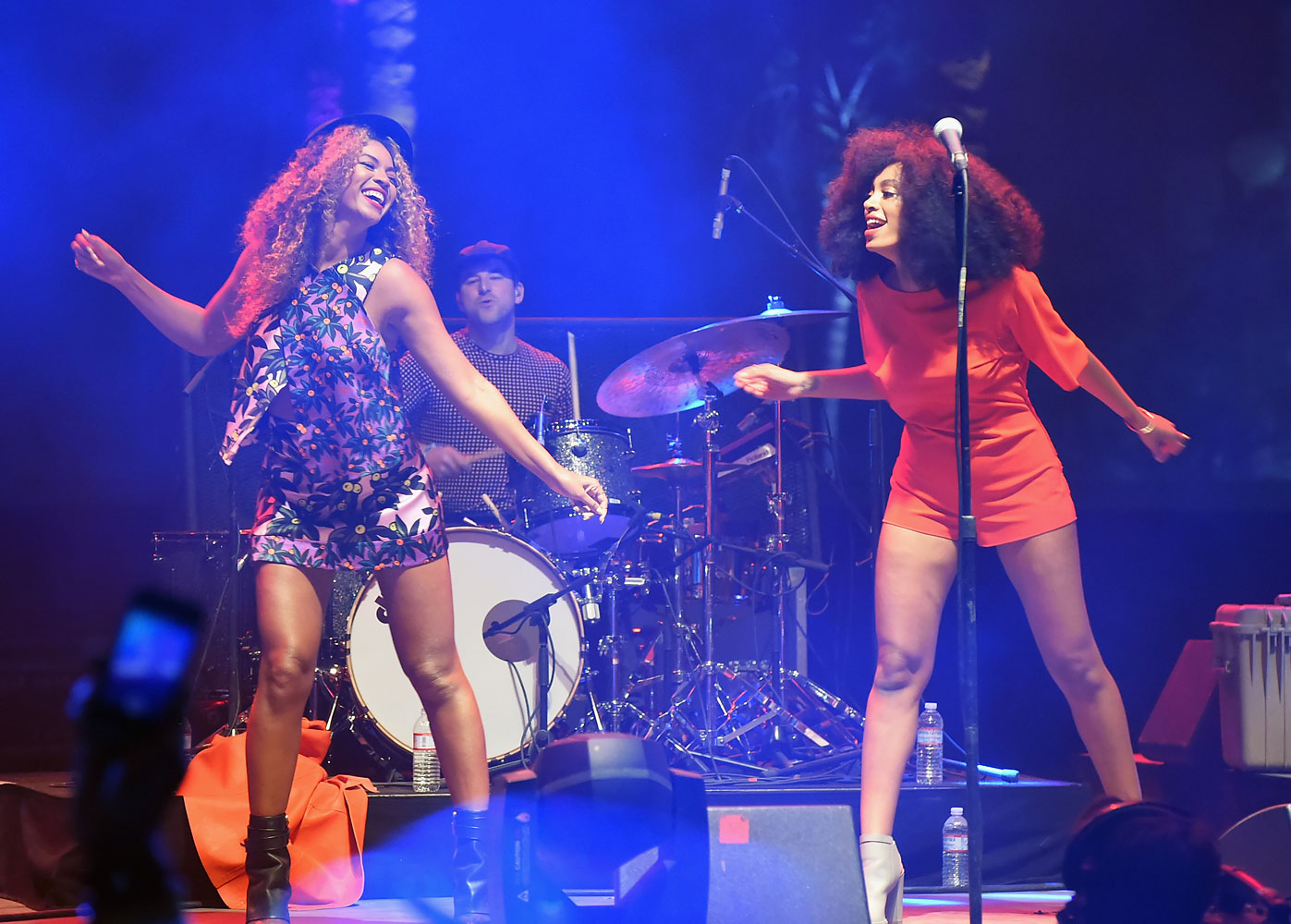 Solange, right, and Beyonce perform onstage during day 2 of the 2014 Coachella Valley Music & Arts Festival at the Empire Polo Club on April 12, 2014 in Indio, California.