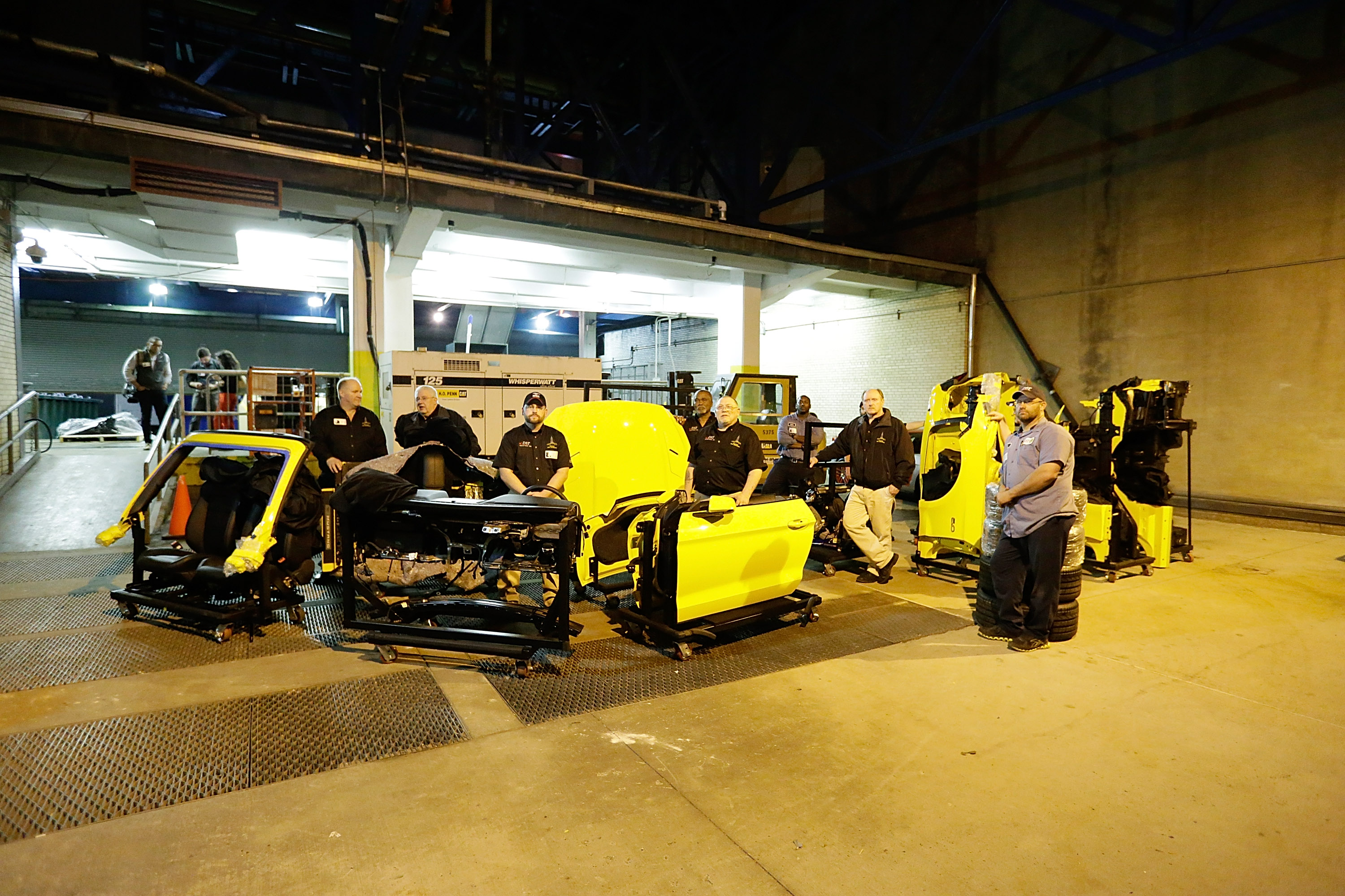 Workers unload a truck with 2015 Ford Mustang components at The Empire State Building on April 14, 2014 in New York City.