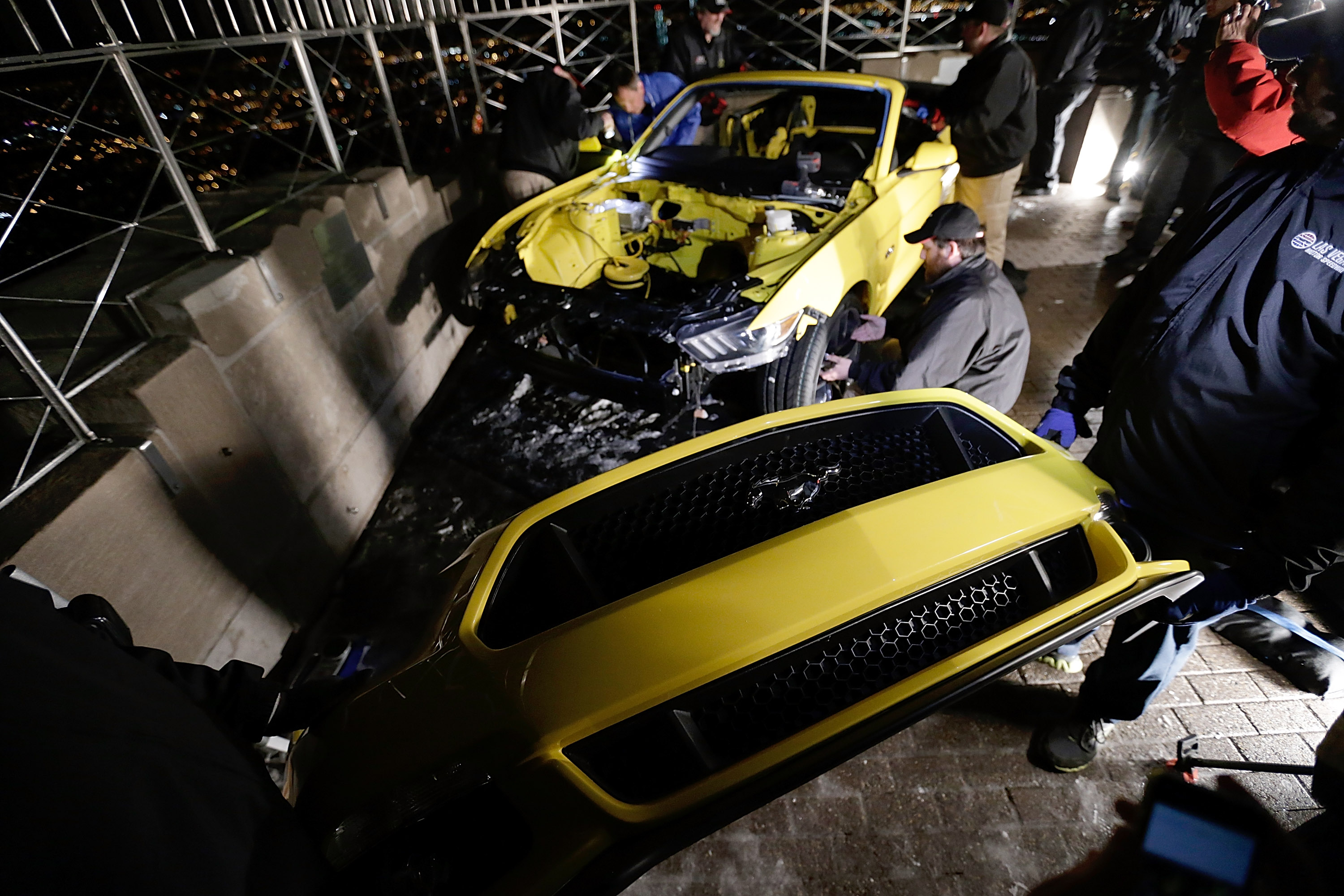 Workers re-assemble the Mustang prior to its unveiling at The Empire State Building on April 16, 2014 in New York City.