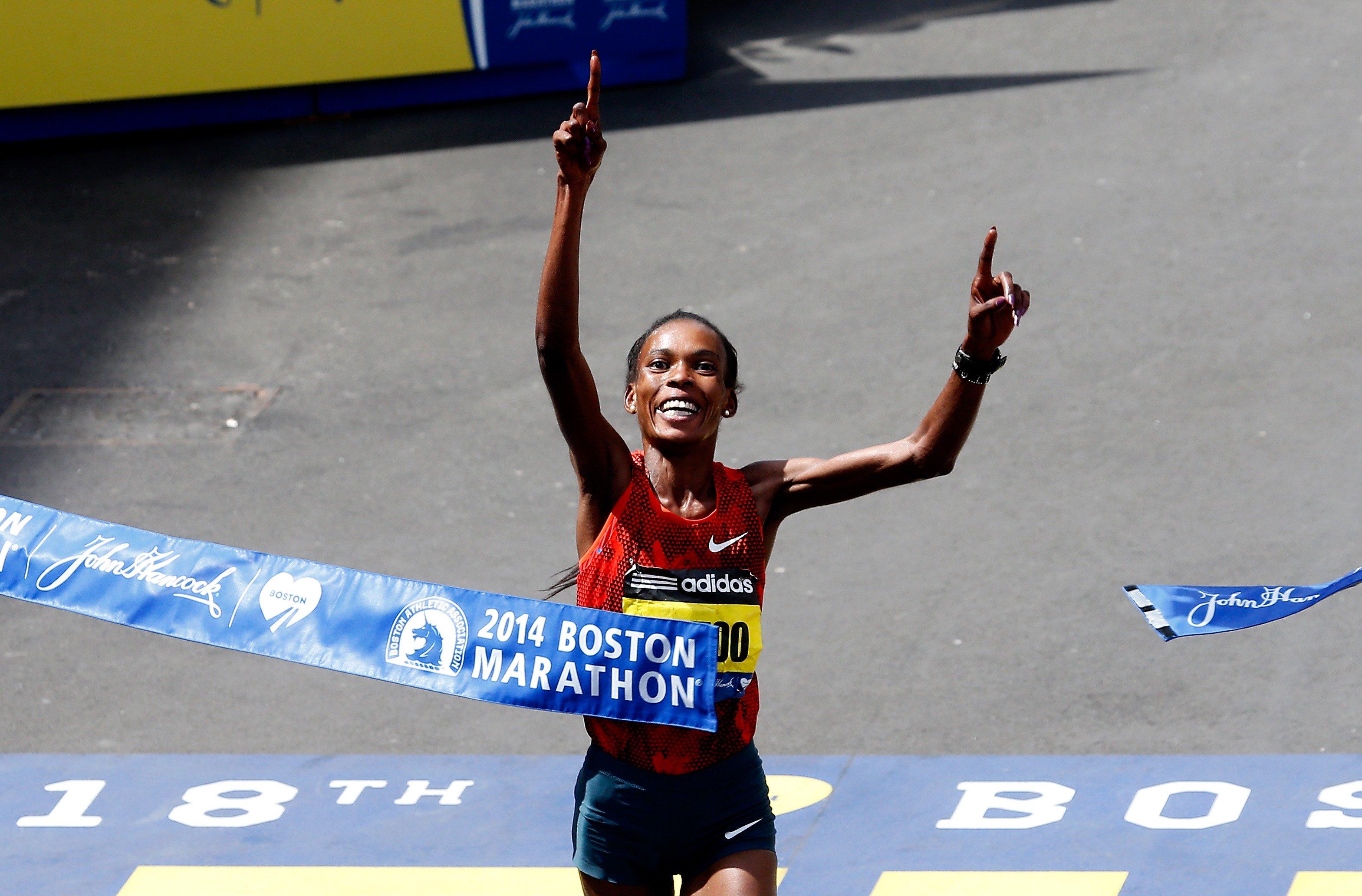 Rita Jeptoo of Kenya crosses the finish line to win the 118th Boston Marathon on April 21, 2014 in Boston, Ma.