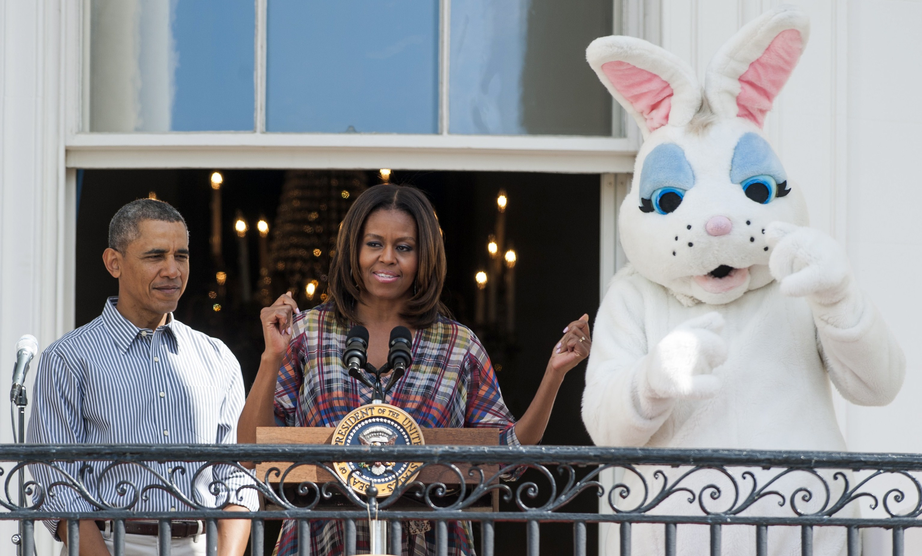 U.S. First Lady Michelle Obama speaks alongside President Barack Obama and the Easter Bunny during the annual White House Easter Egg Roll on the South Lawn of the White House in Washington, D.C., on April 21, 2014