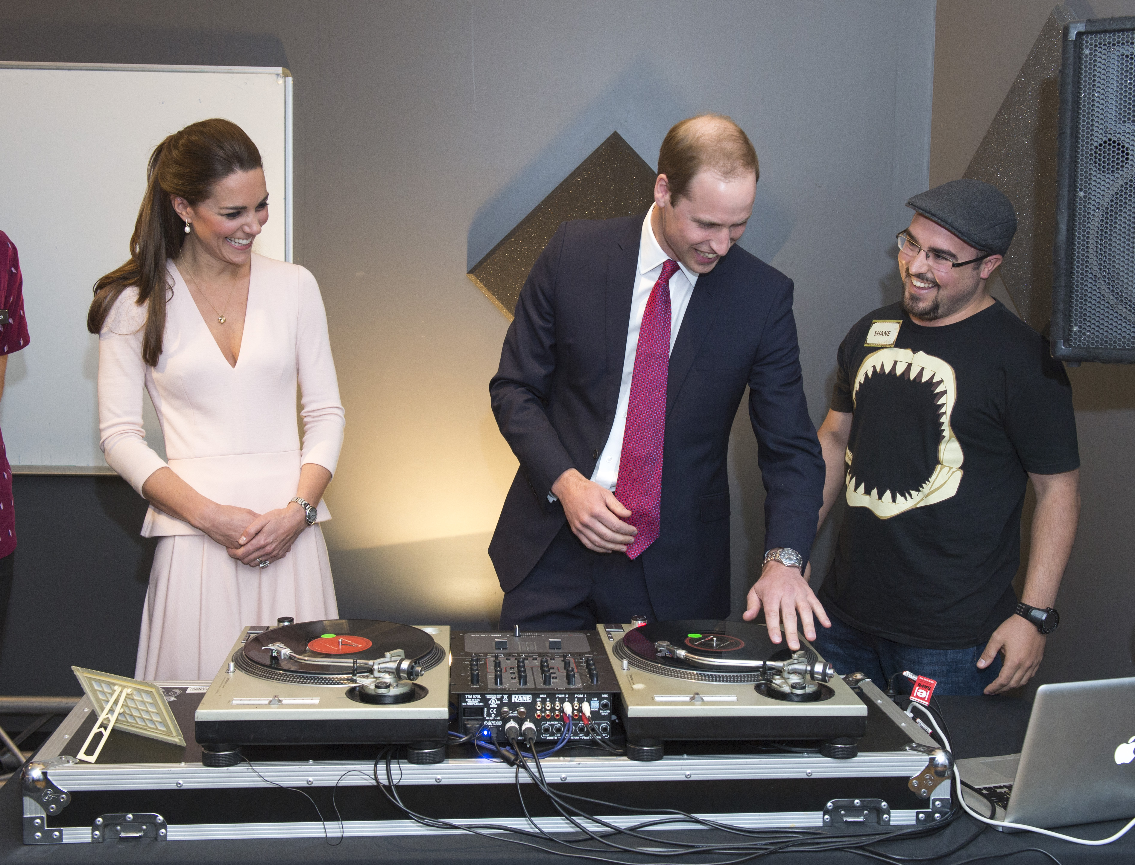 ADELAIDE, AUSTRALIA - APRIL 23:  Catherine, Duchess of Cambridge looks on as Prince William, Duke of Cambridge is shown how to play on DJ decks at the youth community centre, The Northern Sound System in Elizabeth on April 23, 2014 in Adelaide, Australia. The Duke and Duchess of Cambridge are on a three-week tour of Australia and New Zealand, the first official trip overseas with their son, Prince George of Cambridge.  (Photo by Arthur Edwards - Pool/Getty Images)