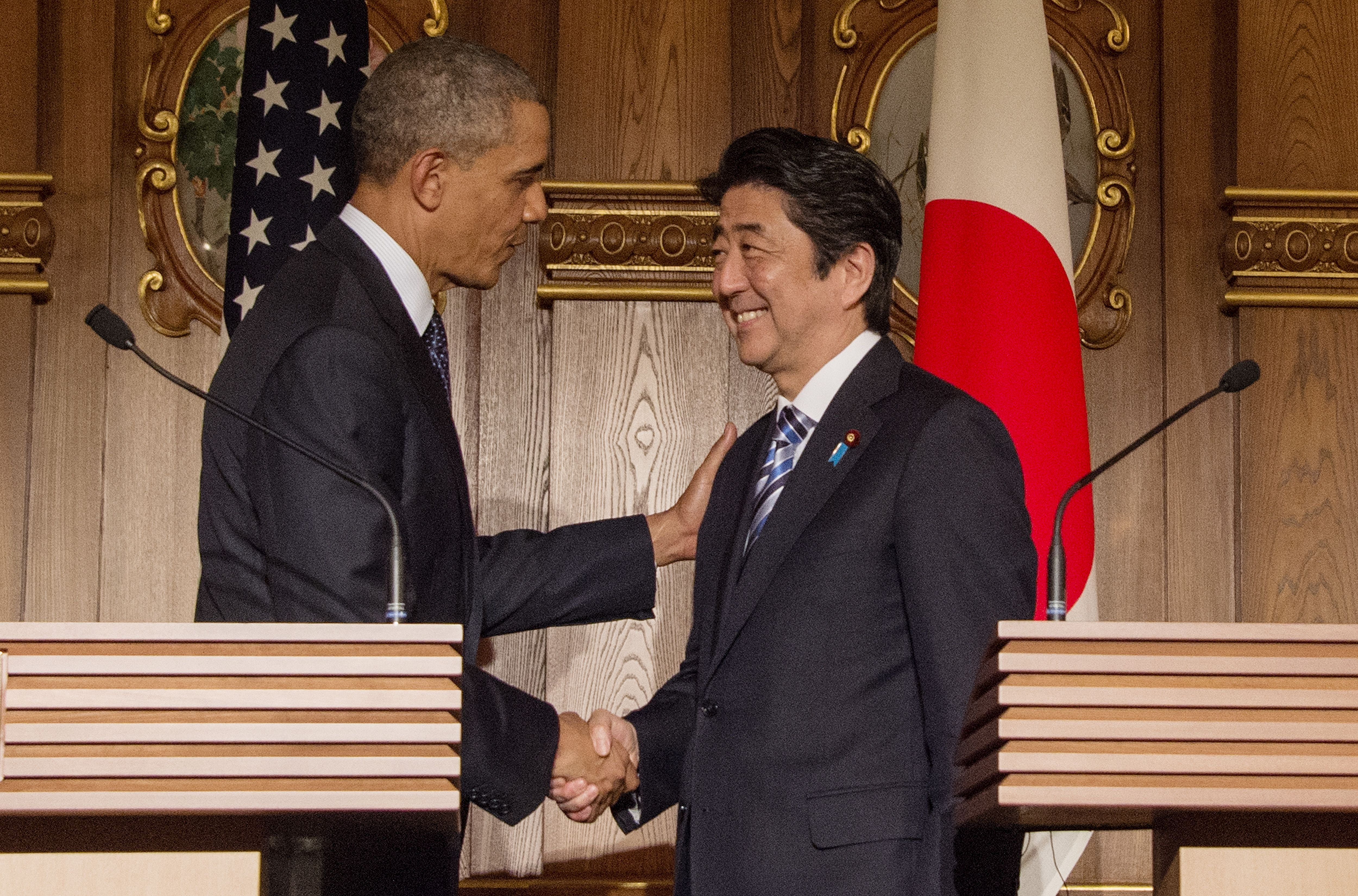 President Barack Obama shakes hands with Japanese Prime Minister Shinzo Abe following a bilateral press conference at the Akasaka Palace in Tokyo on April 24, 2014