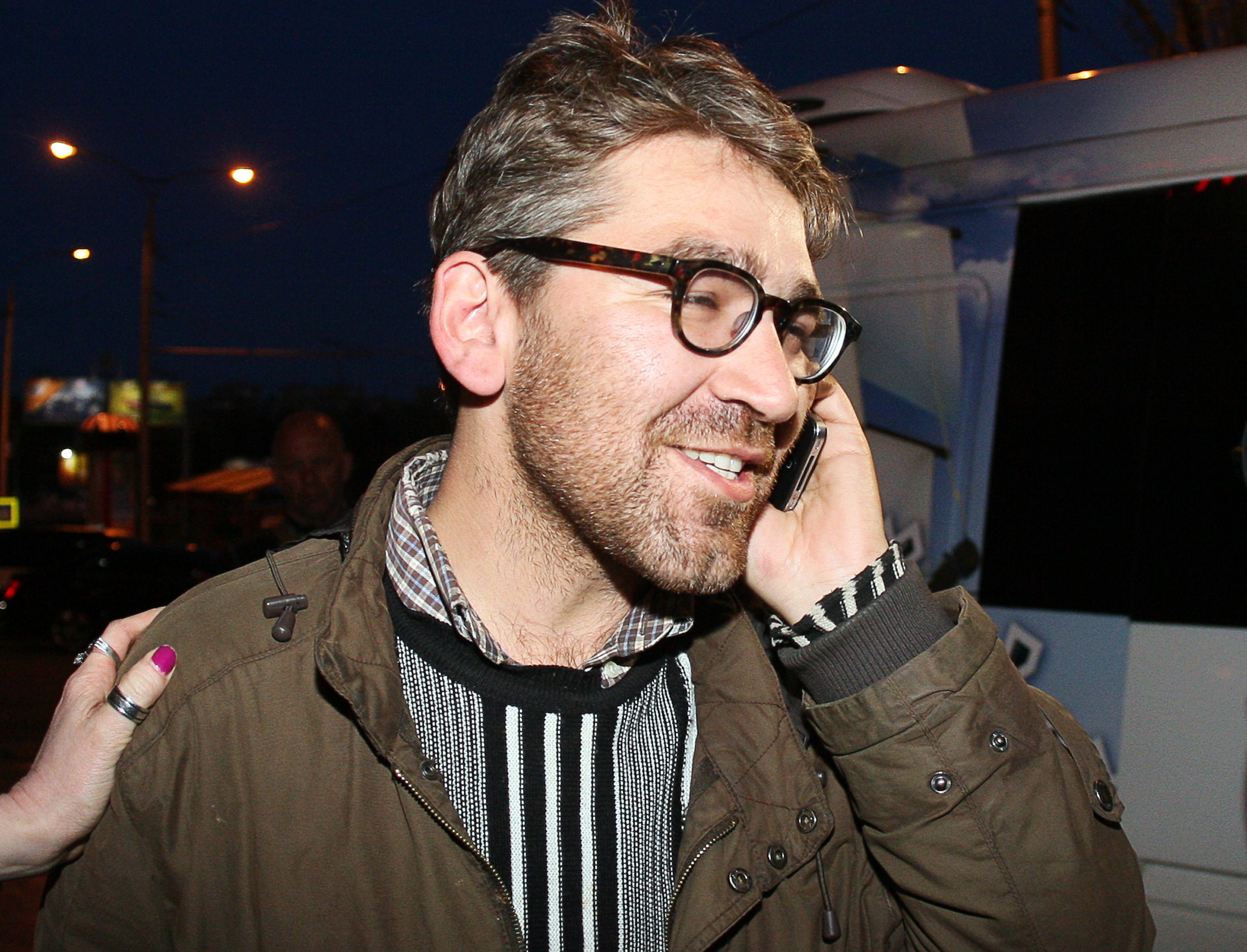 Simon Ostrovsky, who was abducted and held by pro-Kremlin rebels in east Ukraine this week, speaks on a mobile phone as he arrives in a hotel in the eastern Ukrainian city of Donetsk after being freed, on April 24, 2014.