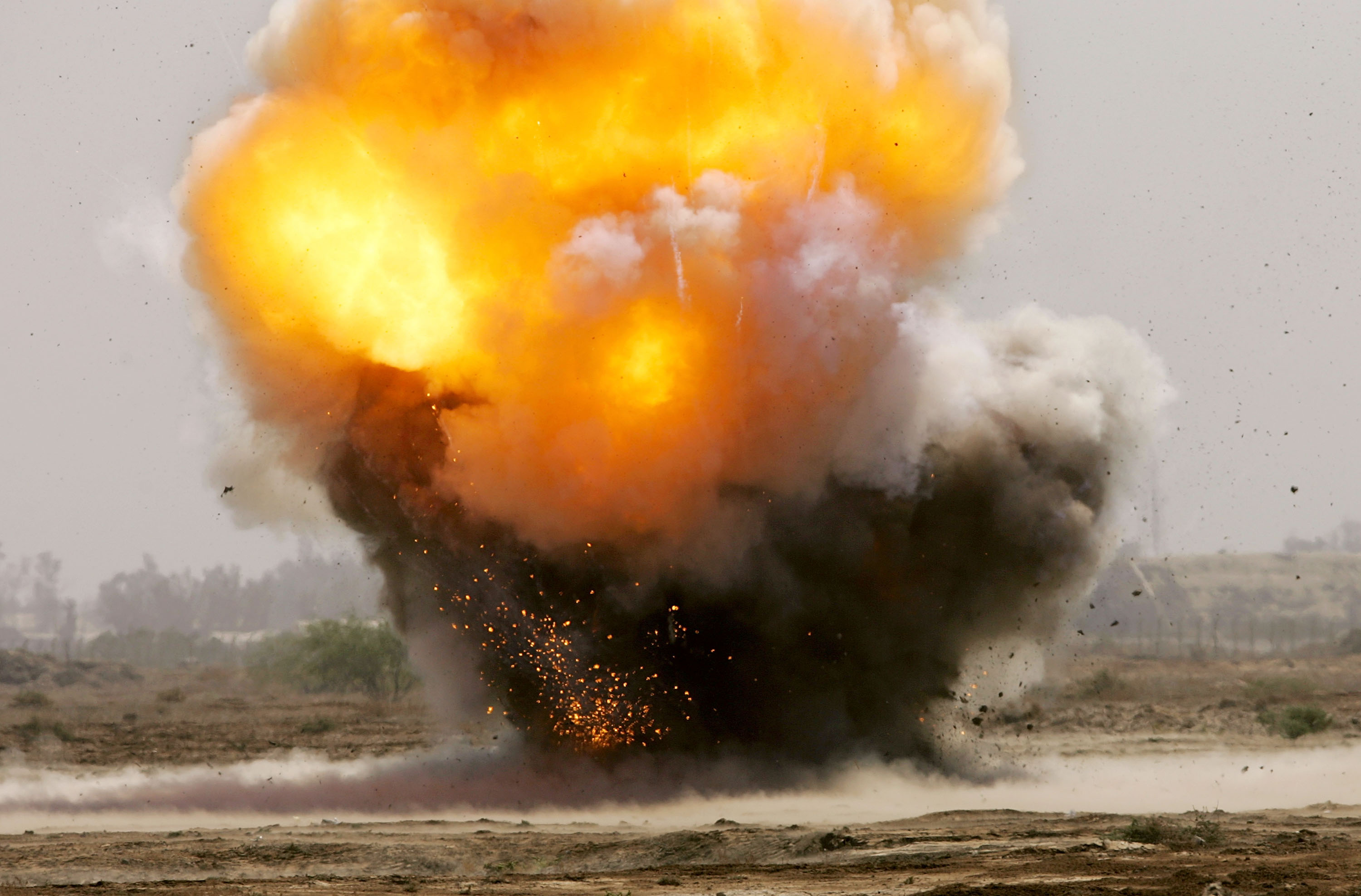 Captured explosives used in roadside bombs are detonated by an Army bomb-disposal unit in Baghdad in 2005.