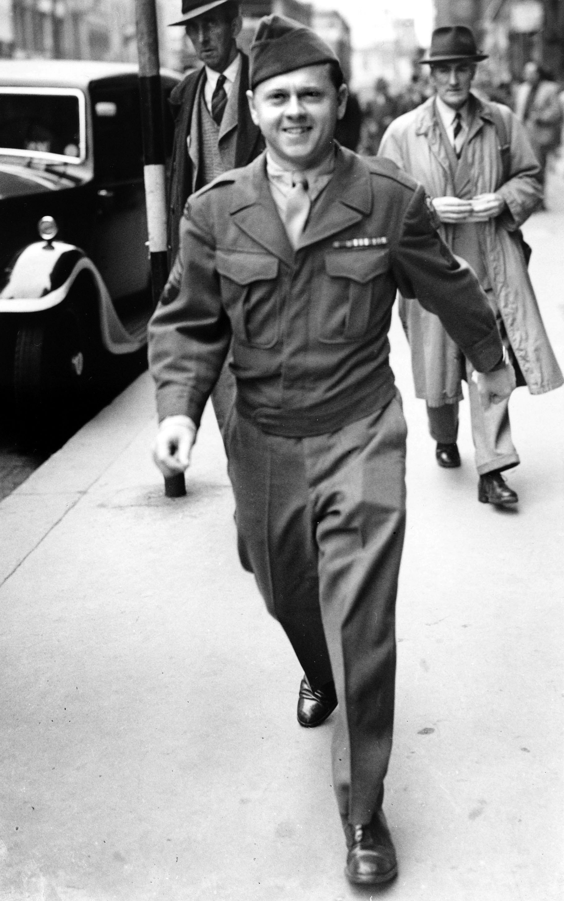 Rooney entered military service in 1944 and served more than 21 months during World War II. Above, he is seen while serving in, London, England on  August 11, 1945.