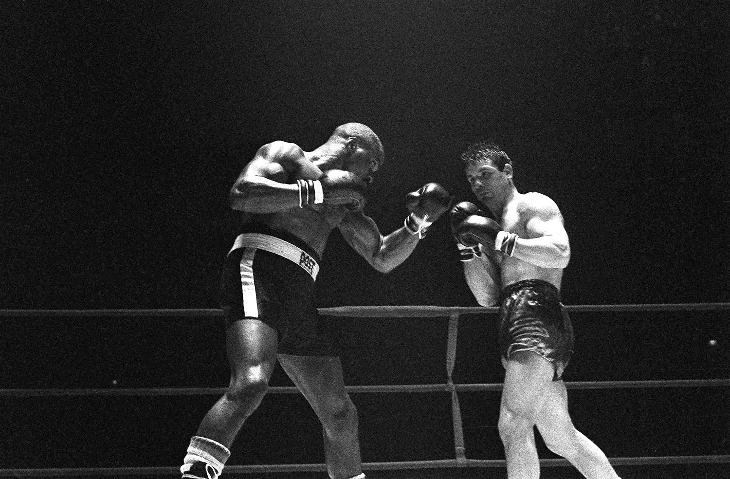 Rubin  Hurricane  Carter, left, knocks out Italian boxer Fabio Bettini in the 10th and last round of their fight at the Falais Des Sports in Paris, Feb. 23, 1965.