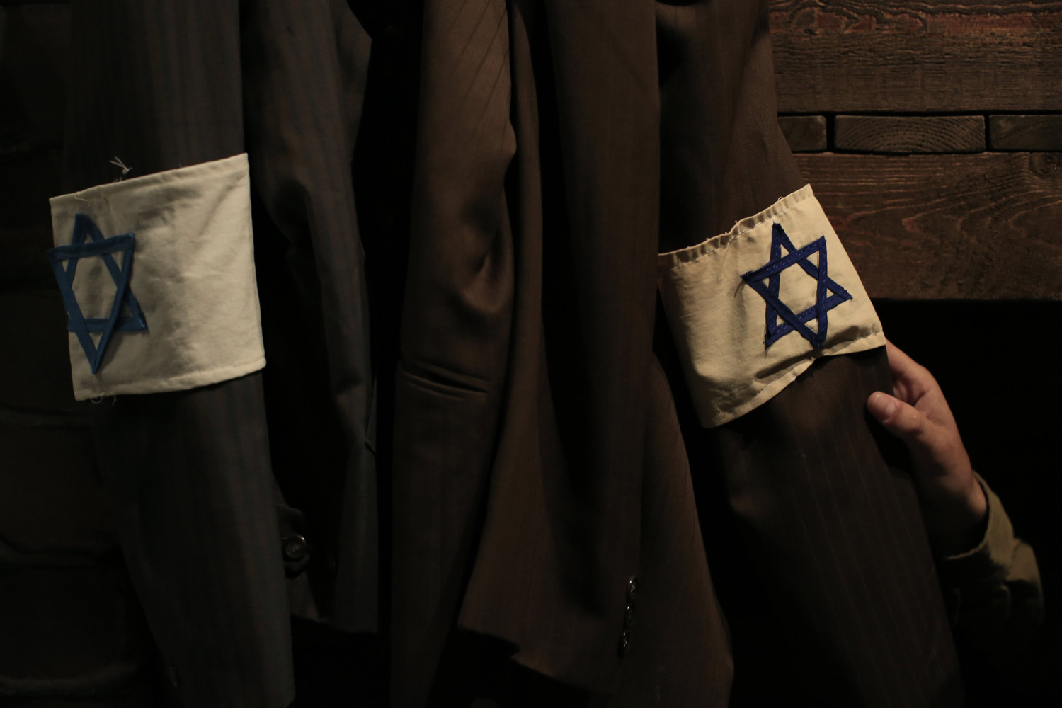 Apr. 27, 2014. An Israeli officer looks at a jacket with a Star of David arm band, in a model of the headquarters bunker of the Jewish Combat Organization (ZOB) Mila 18 in the Warsaw Ghetto at the museum  From Holocaust to Revival  in Kibbutz Yad Mordechai near the costal town of Ashkelon, Israel.
