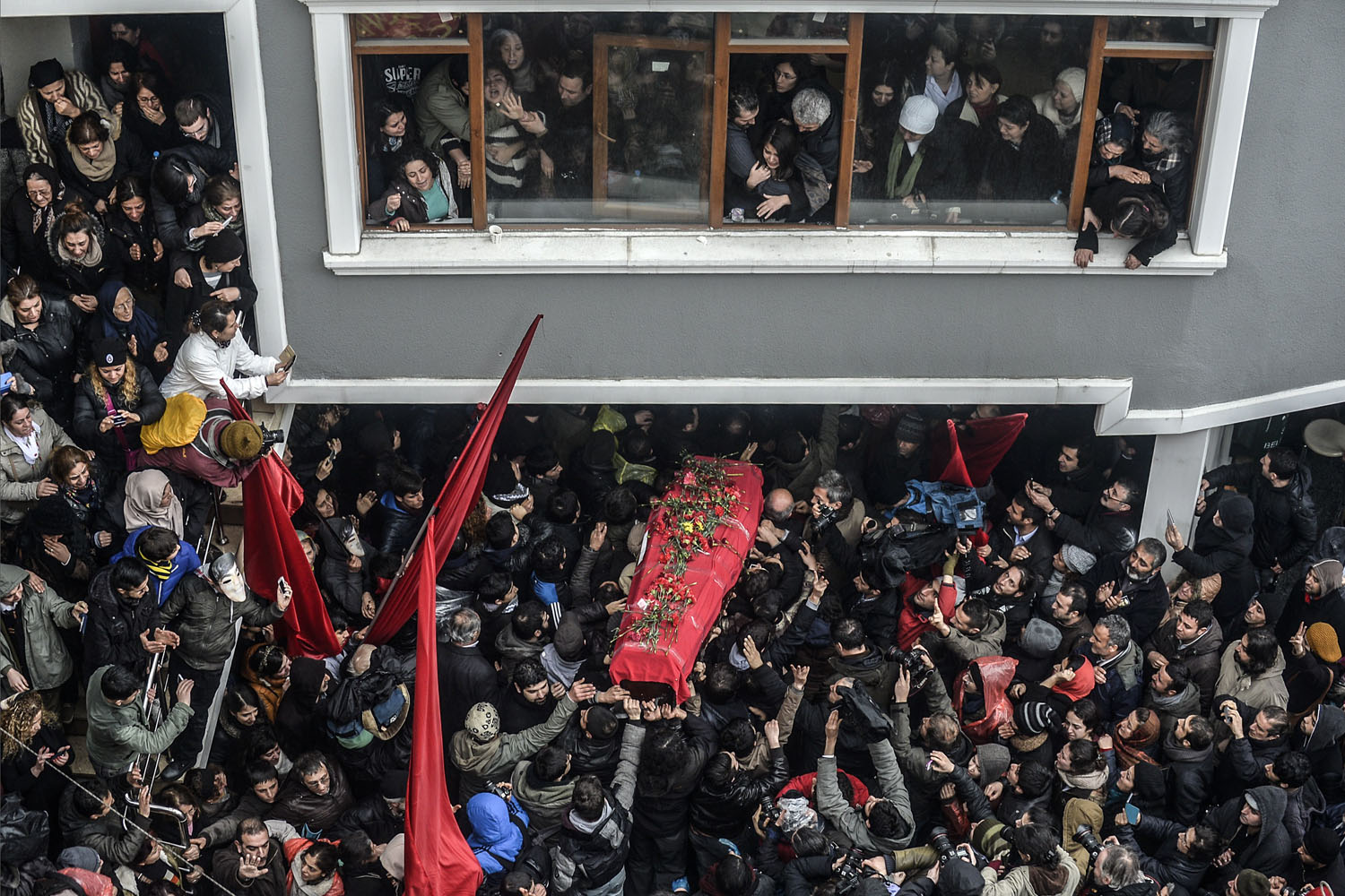 The coffin of Berkin Elvan is carried in Istanbul,  March 11, 2014. Berkin Elvan, who had been in a coma since June 2013 after being struck in the head by a gas canister during a police crackdown on protesters, died March 11.