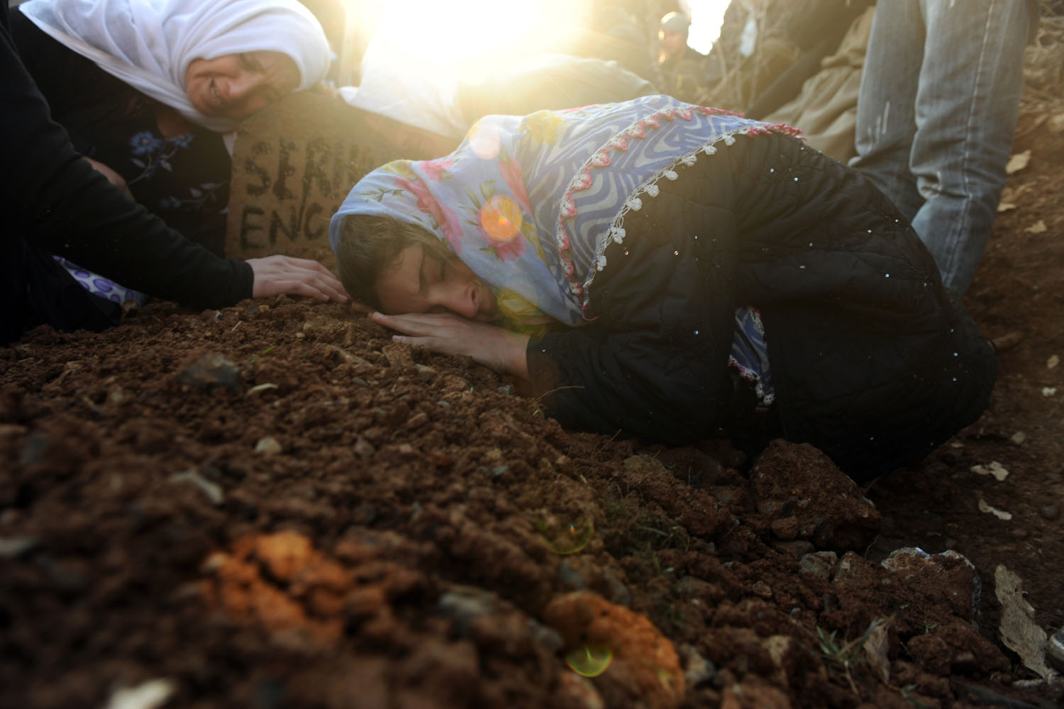 Women mourn for victims of a Turkish air raid at the Gulyazi Village cemetery in Sirnak province, Turkey, Dec. 30, 2011.