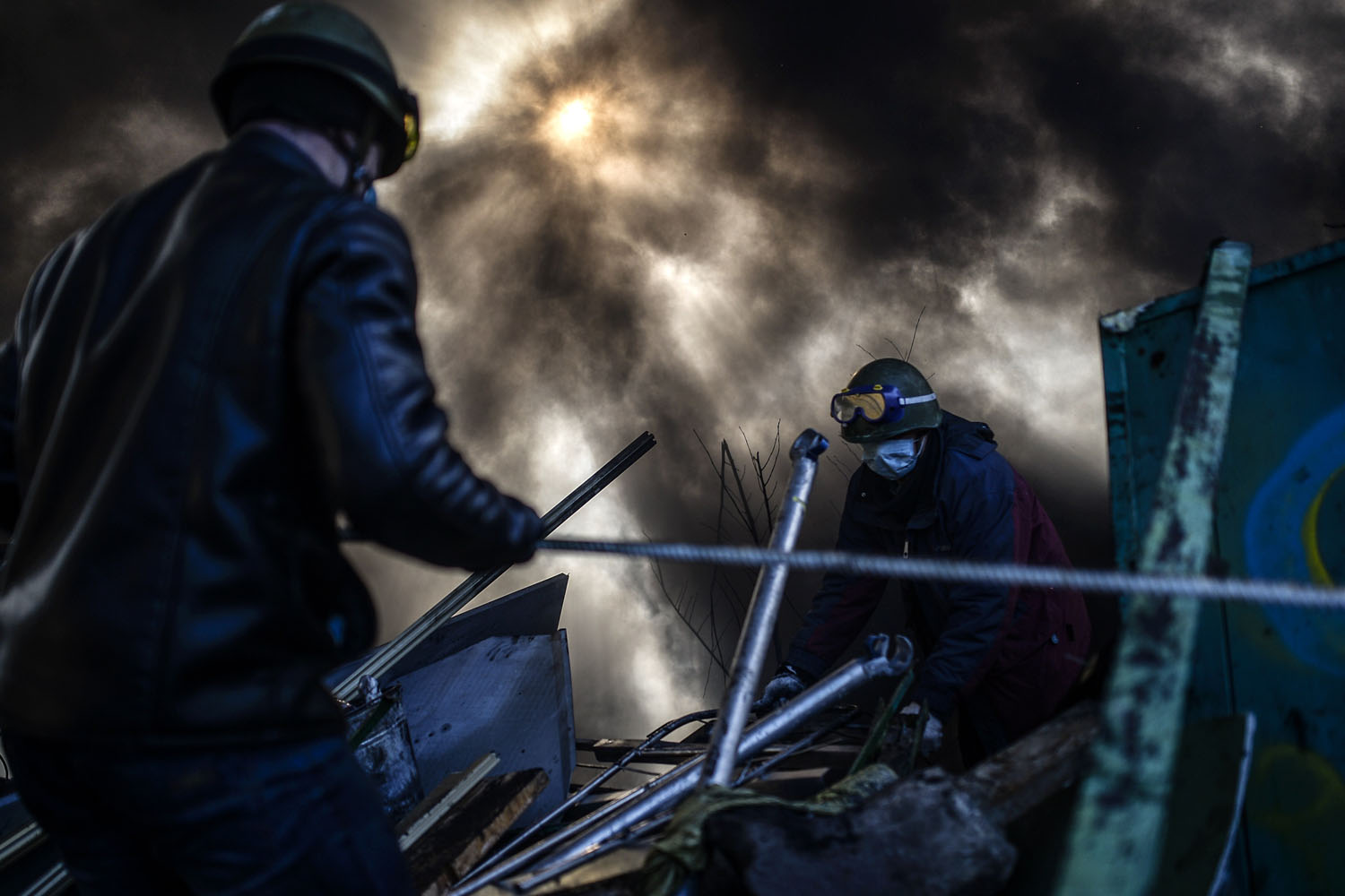 Protesters build a barricade early in the morning on at Independence Square in Kiev, Ukraine, Feb. 21, 2014.