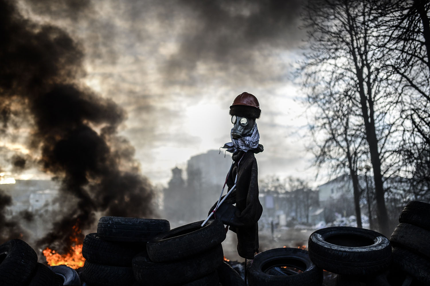 A scarecrow like mock anti-government protestor is pictured on a barricade between protestors and government forces in Kiev, Ukraine, Feb. 21, 2014