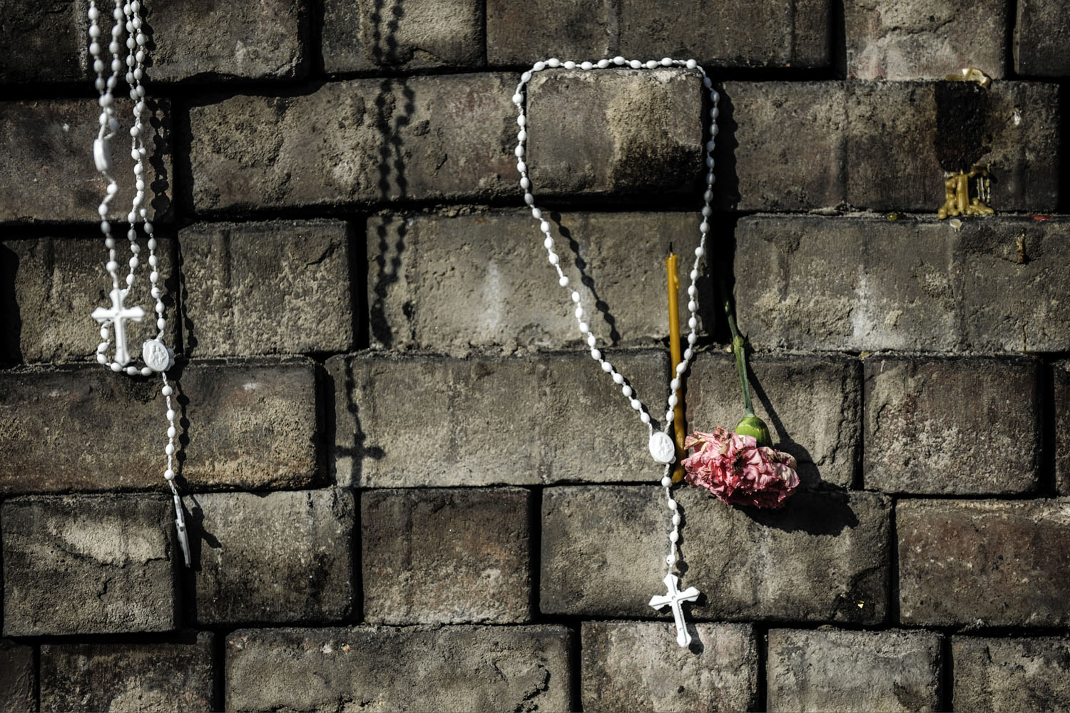 Crosses and flowers left by people near a makeshift memorial in homage to anti-government protesters killed in clashes with riot police on Kiev's Independence Square, Feb. 24, 2014.