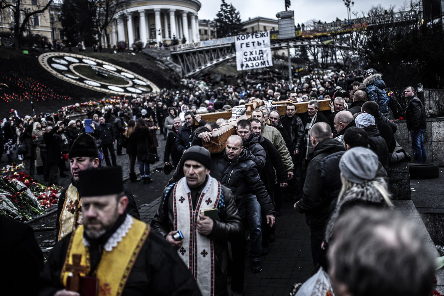 People hold a large crucifix during a procession at Kiev's Independence Square, Feb. 25, 2014.