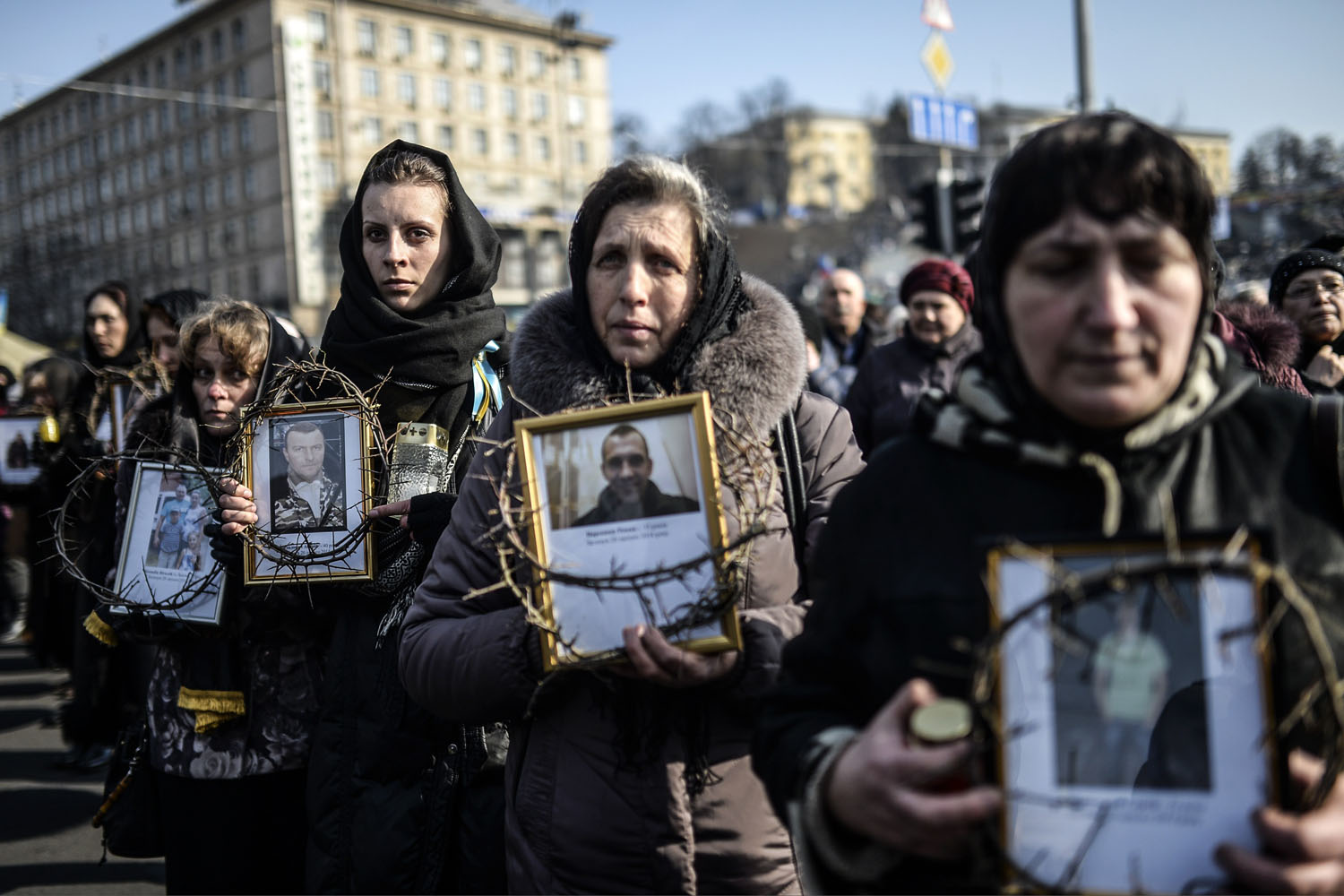 Women hold pictures of protesters who were killed in clashes with police during recent demonstrations as they take part in a commemerative procession in central Kiev, Ukraine, Feb. 26, 2014.