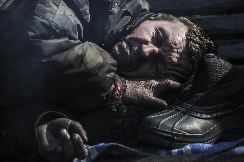 A protestor rests near barricades in central Kiev, Ukraine, Feb. 26, 2014.