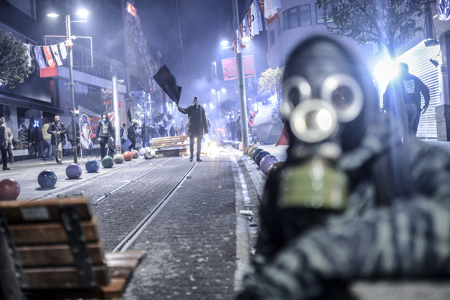 A protester waves a black flag during clashes with riot police in Kadikoy, on the Anatolian side of Istanbul,  March 11, 2014.