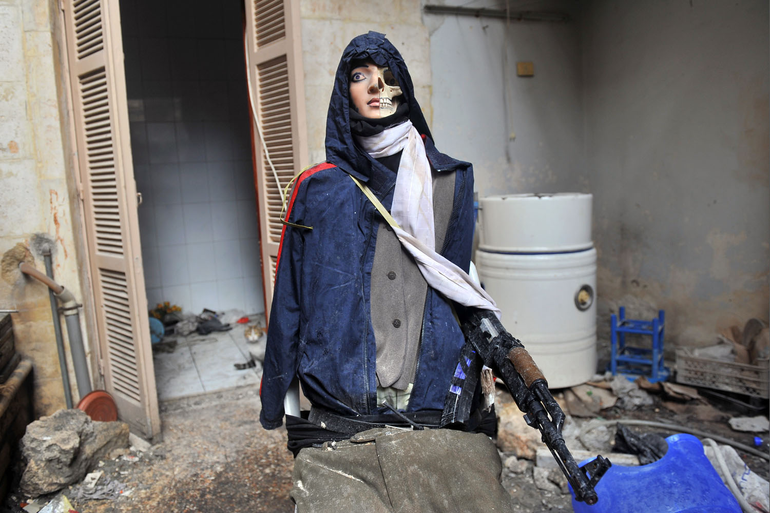 A dummy is displayed in an apartment used by rebel fighters in the Salaheddine neighborhood of Aleppo, Syria, Feb. 16, 2013.