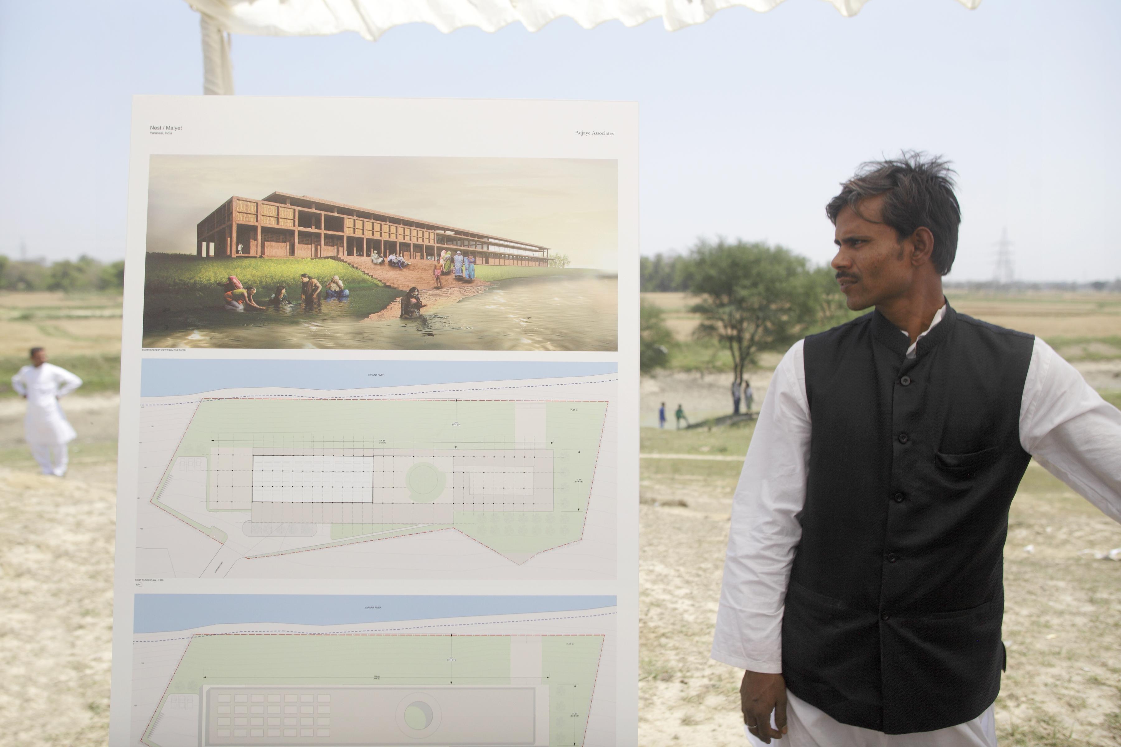 A Varanasi man checks the design proposed by David Adjaye.