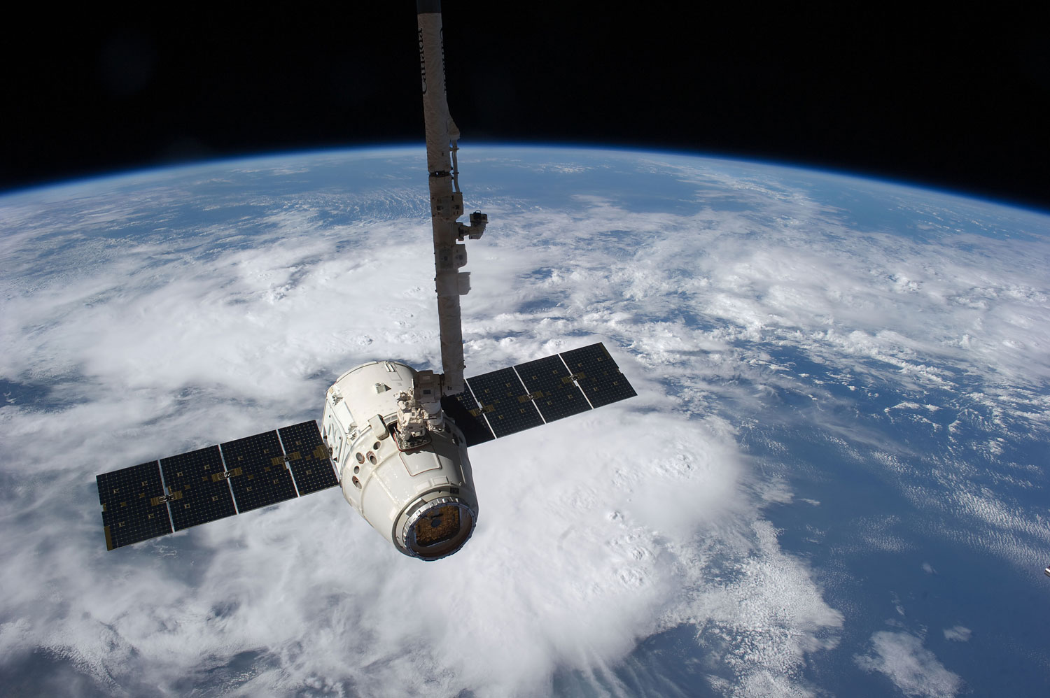 This image provided by NASA shows the SpaceX Dragon cargo craft just prior to being released by the International Space Station's robotic arm on May 31, 2012