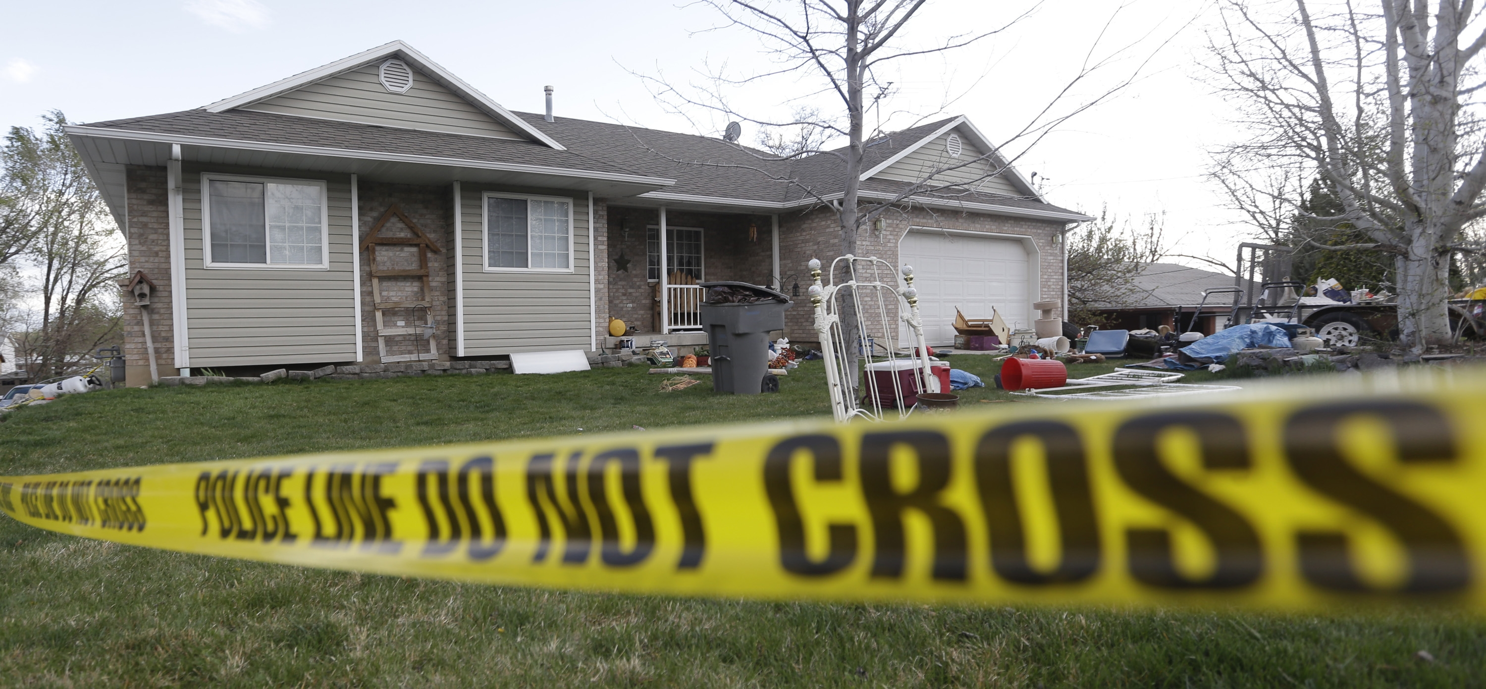 Police tape surrounds the Utah home of Megan Huntsman, who admitted to killing six of her infant children and hiding their bodies