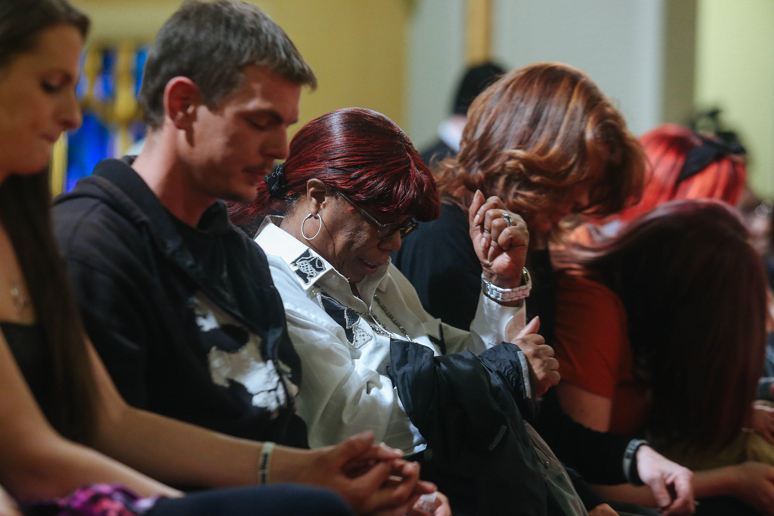 Retired nurse Deborah Hughes saved a man's life when she shielded him from an attacking mob. Here she is seen at praying during a vigil at Little Rock Baptist Church in Detroit on Thursday April 10, 2014.