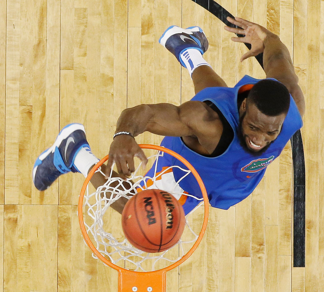 Florida center Patric Young dunks during practice for an NCAA Final Four tournament college basketball semifinal game, April 4, 2014, in Dallas.