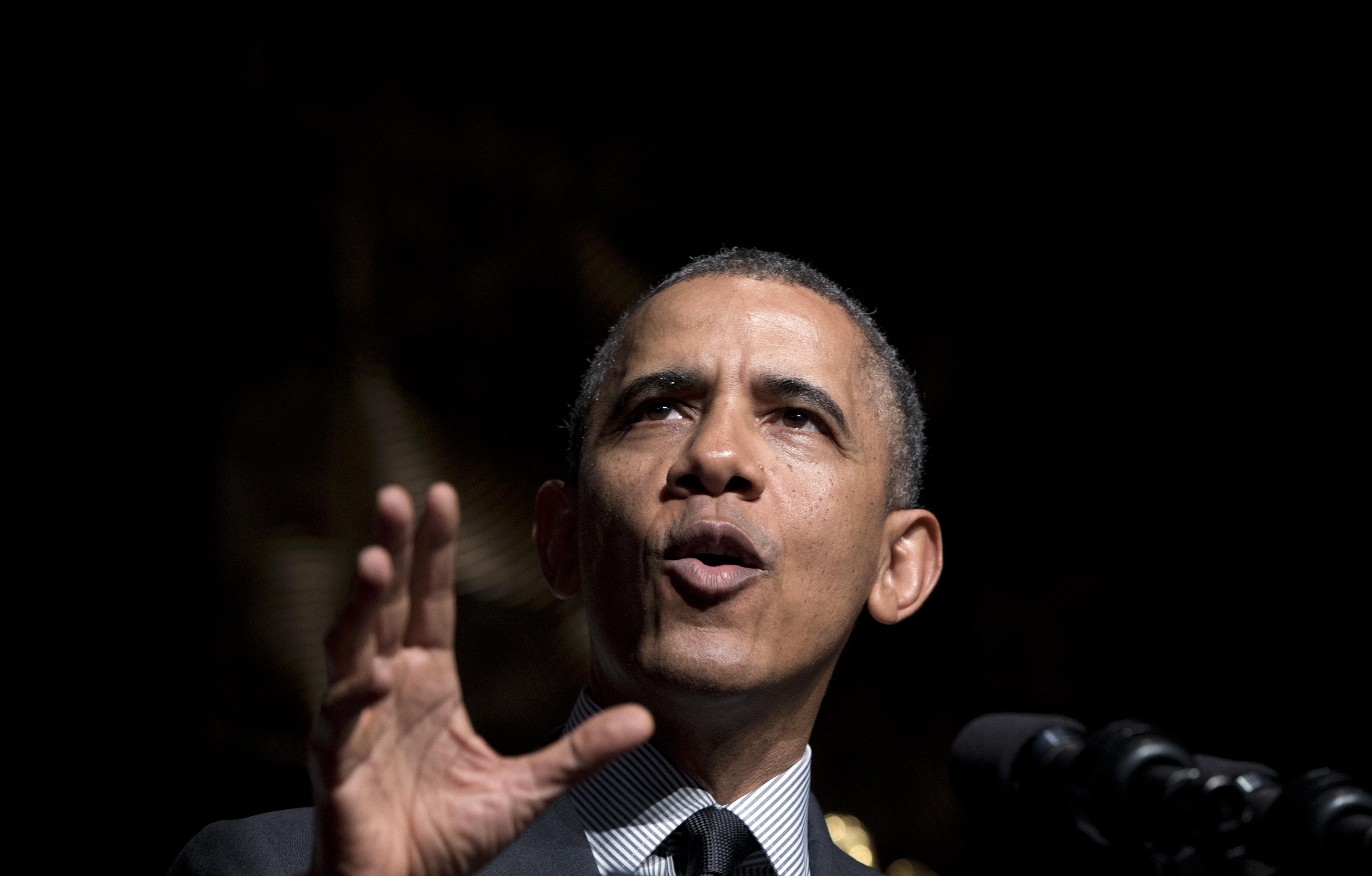 President Barack Obama gestures as he speaks at Rev. Al Sharpton's National Action Network's conference in New York, April 11, 2014