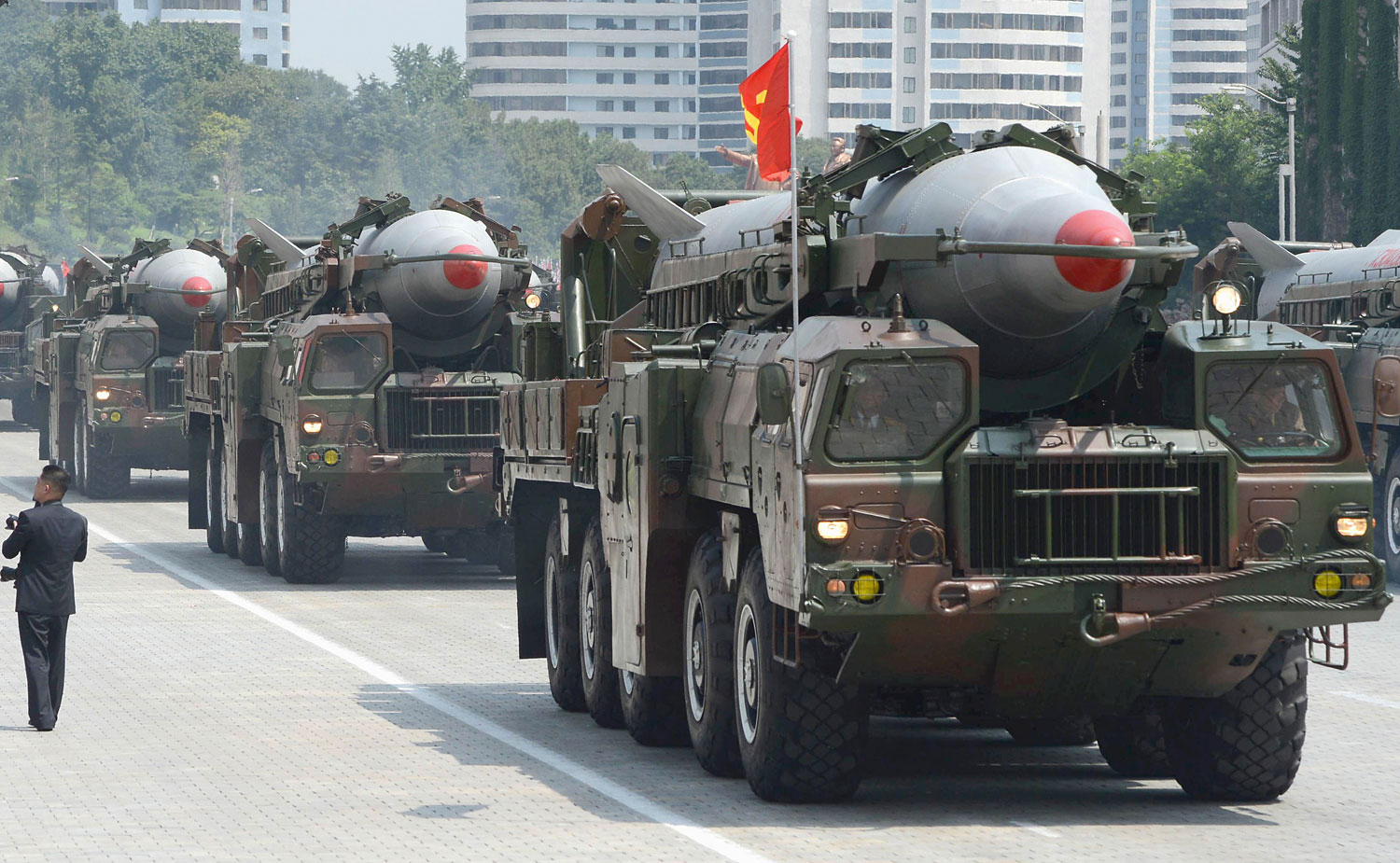 In this July, 2013 photo, military trucks carry Rodong missiles during a military parade at Kim Il Sung Square in Pyongyang.