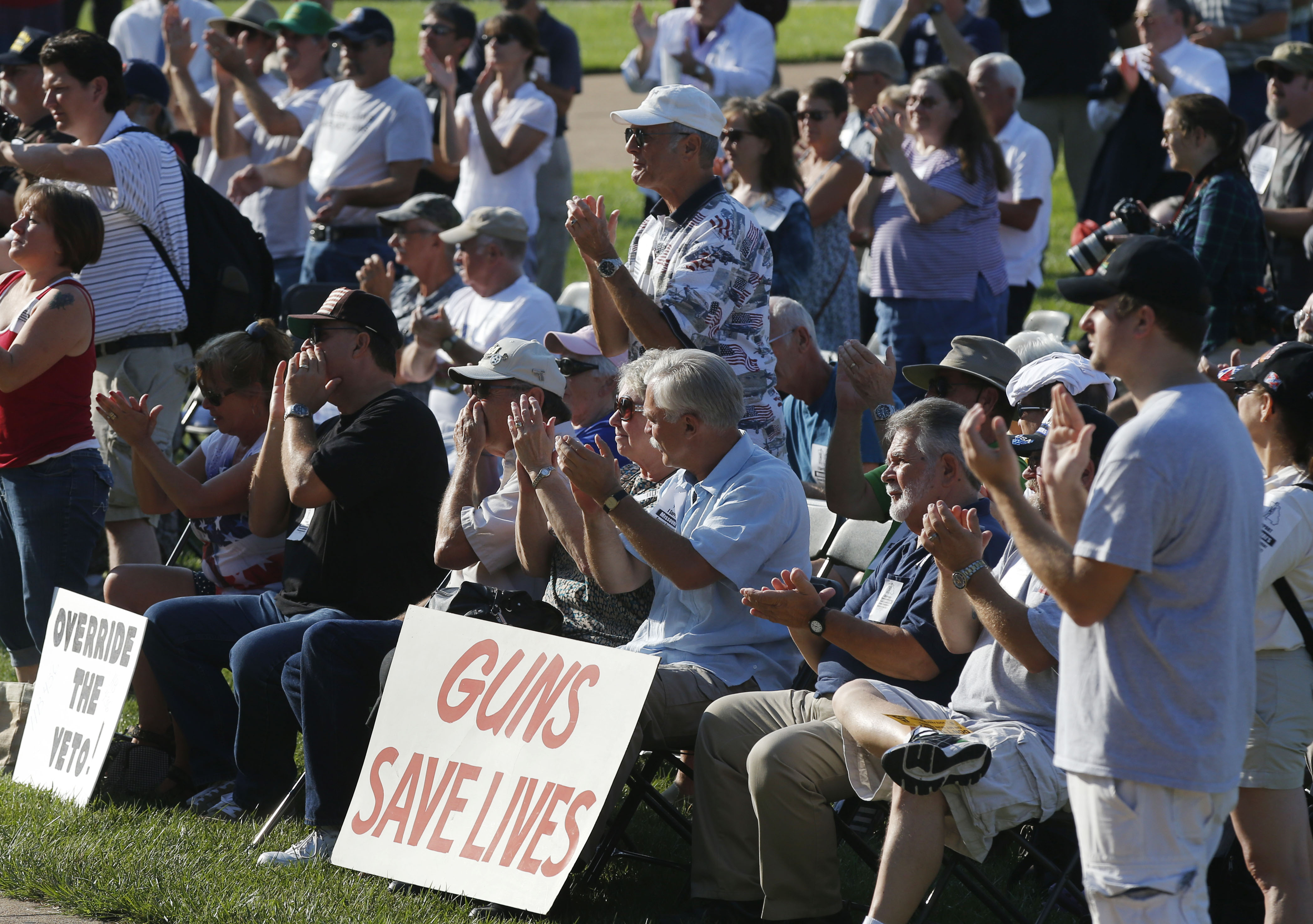 Participants applaud during a rally to override Gov. Jay Nixon's veto of a gun bill on the south lawn of the Missouri State Capital in Jefferson City, Mo., Wednesday, Sept. 11, 2013.