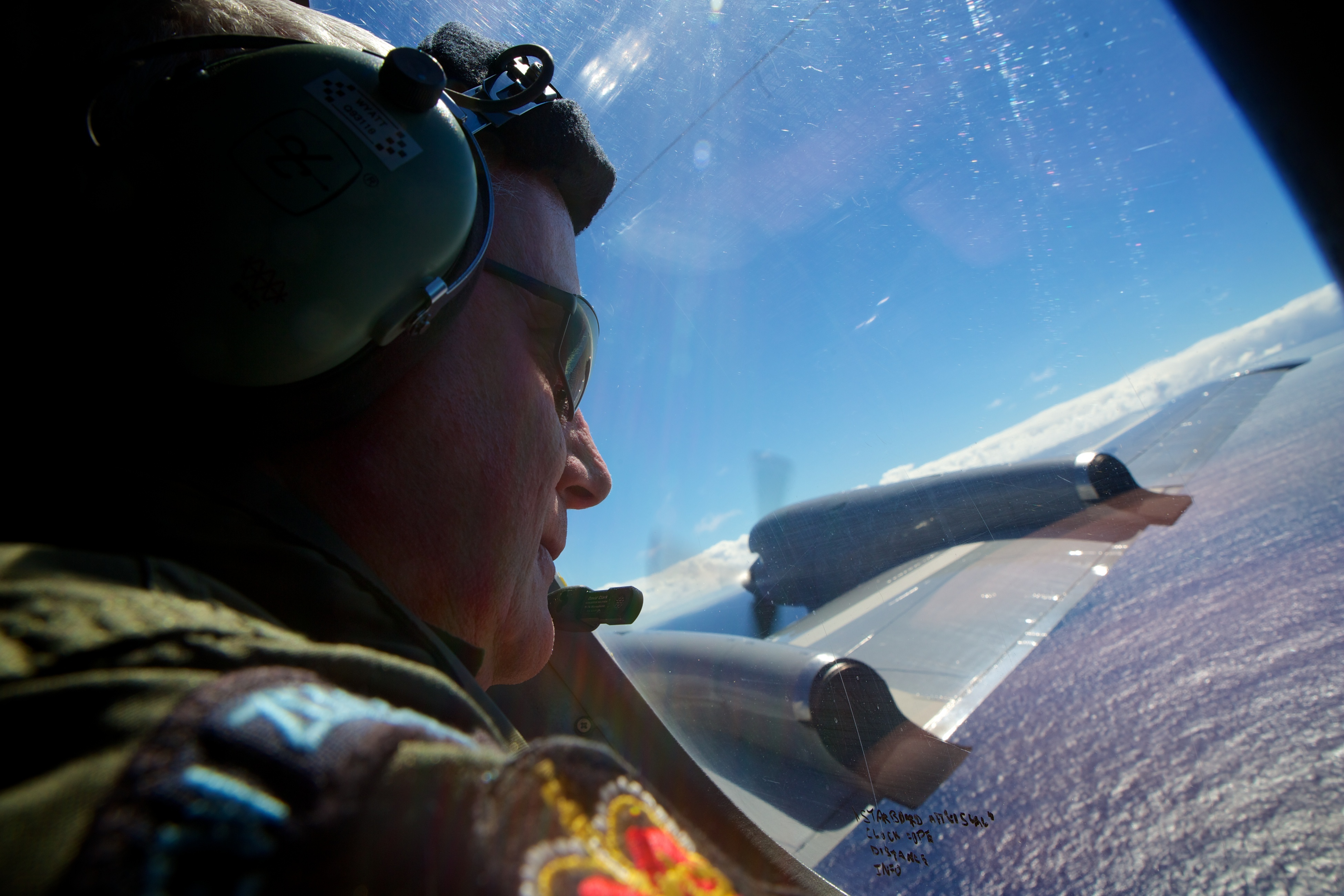 Sergeant Trent Wyatt,  a crew member of a Royal New Zealand Air Force P-3 Orion, takes part in the search for the missing Malaysia Airlines Flight MH370 over the Indian Ocean on April 11, 2014