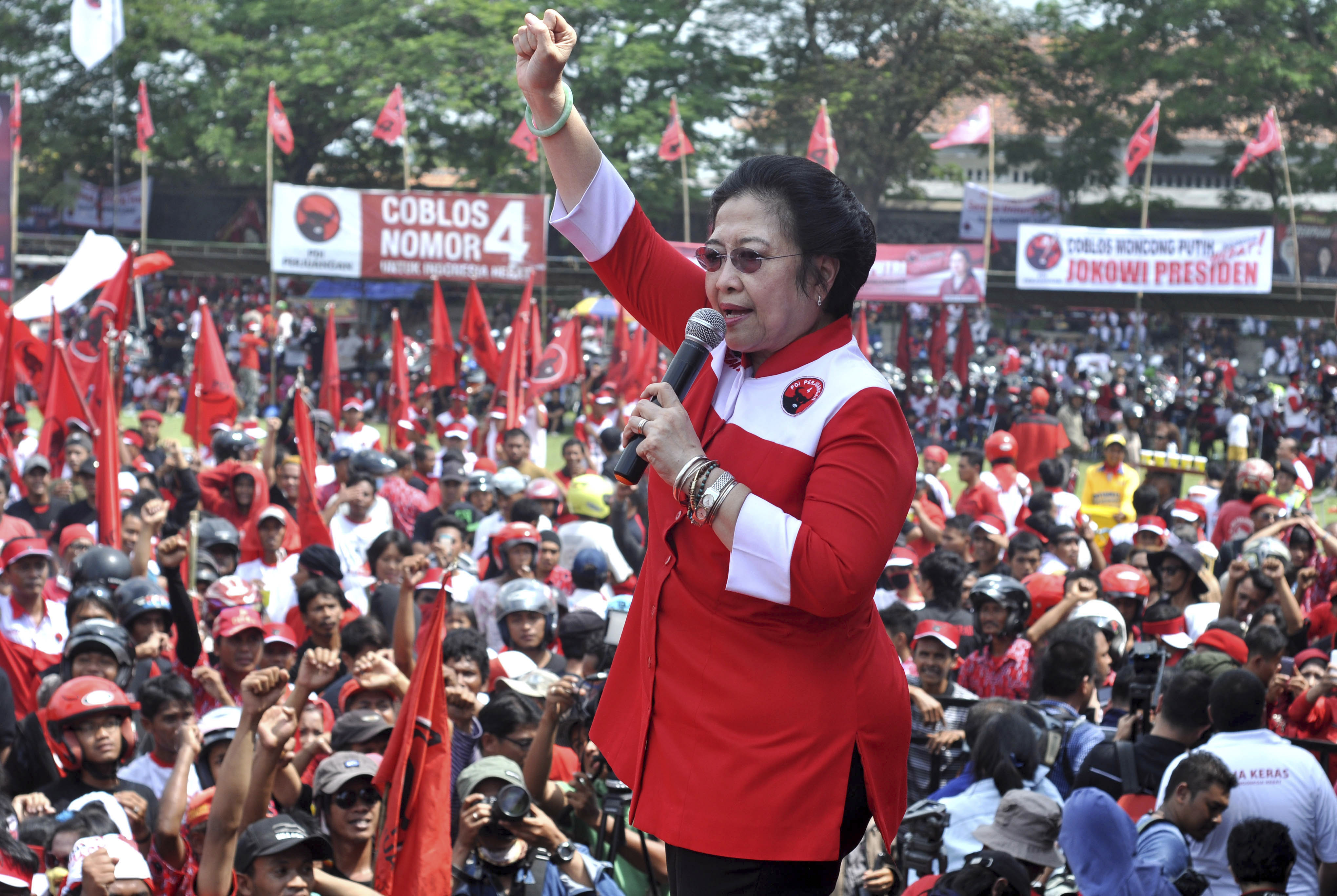 Indonesian Democratic Party of Struggle chairwoman Megawati Sukarnoputri shouts slogans during a campaign rally in the Indonesian town of Klaten on April 5, 2014