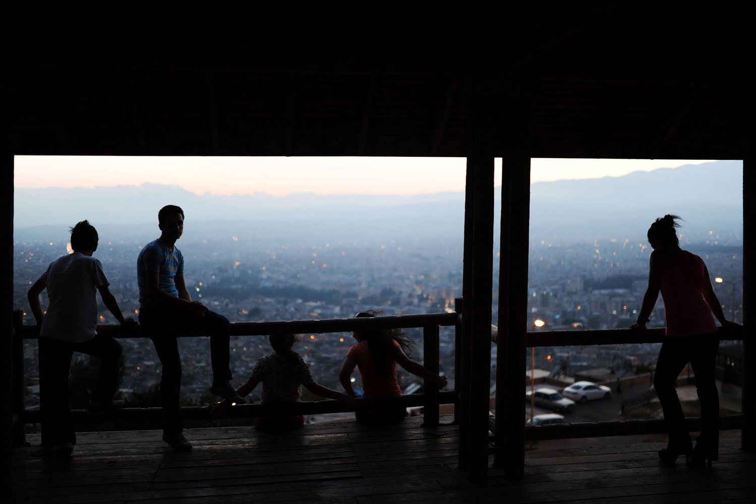 Youths look out from an observation point at the city of Antakya, Turkey, Aug. 29, 2013.