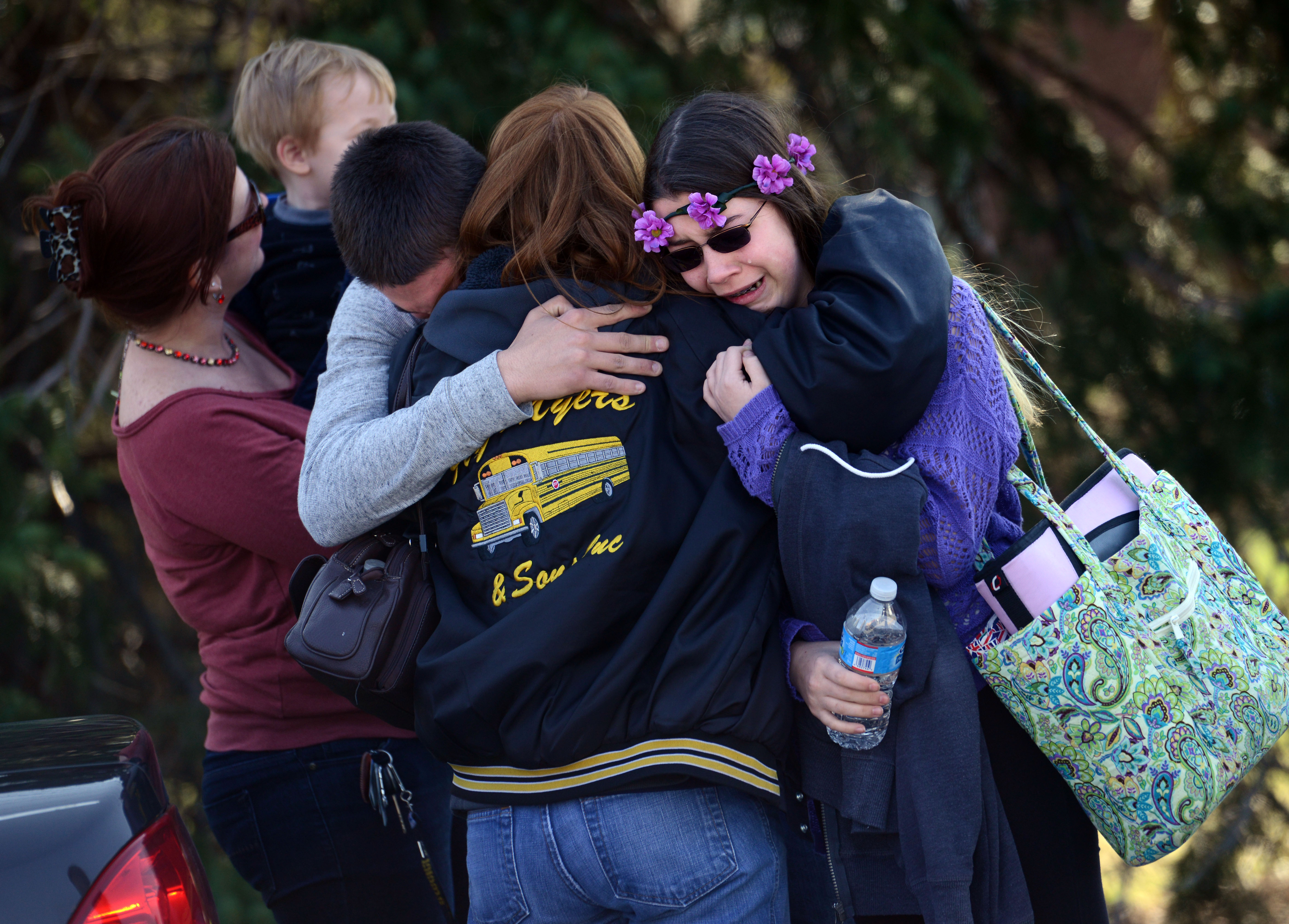 Parents and students embrace near Franklin Regional High School after more than a dozen students were stabbed by a knife wielding suspect at the school in Murrysville, Pa., April 9, 2014.