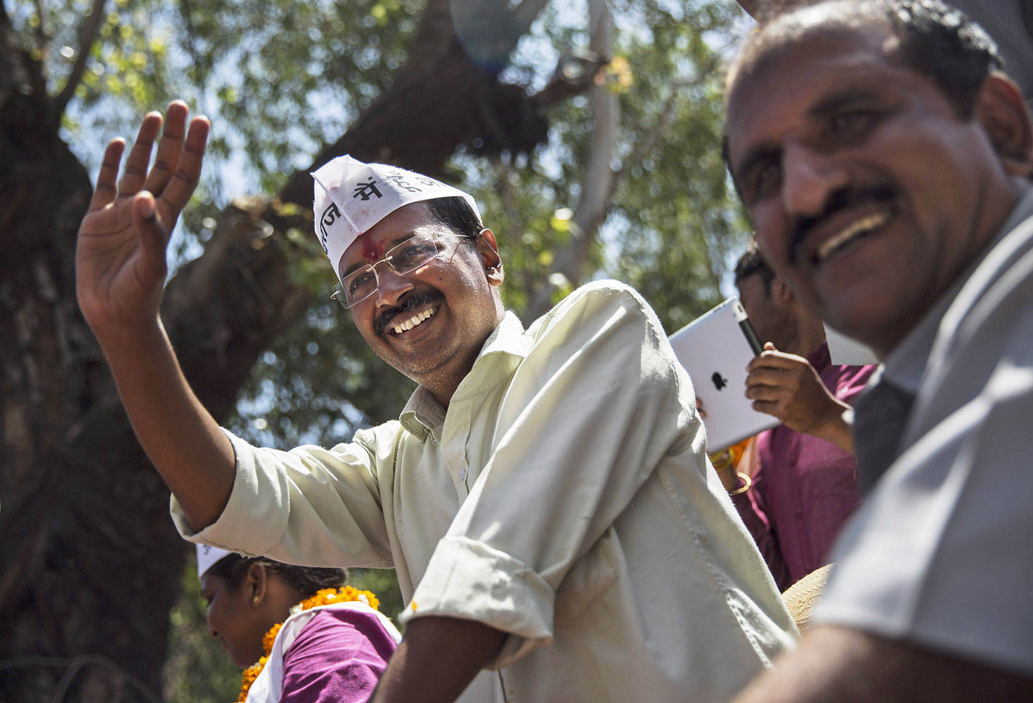 Leader of the AAP and anti-corruption activist  Arvind Kejriwal waves to supporters while campaigning on April 8, 2014 in New Delhi.