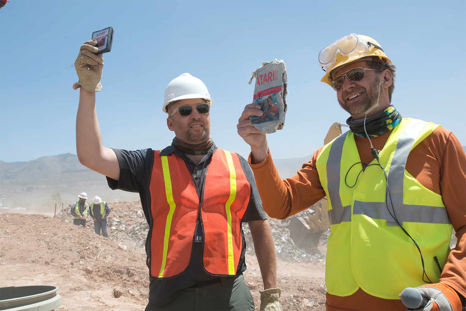 Zak Penn, director of of an upcoming Xbox original documentary about Atari, and Andrew Reinhard, archaeologist,                    hold up an Atari 2600 E.T. game cartridges excavated in a New Mexico landfill on                    April 26, 2014, in Alamogordo, N.M.