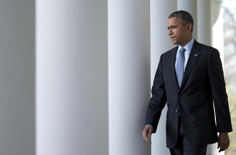 President Obama walks to the Rose Garden of the White House on April 1, 2014
