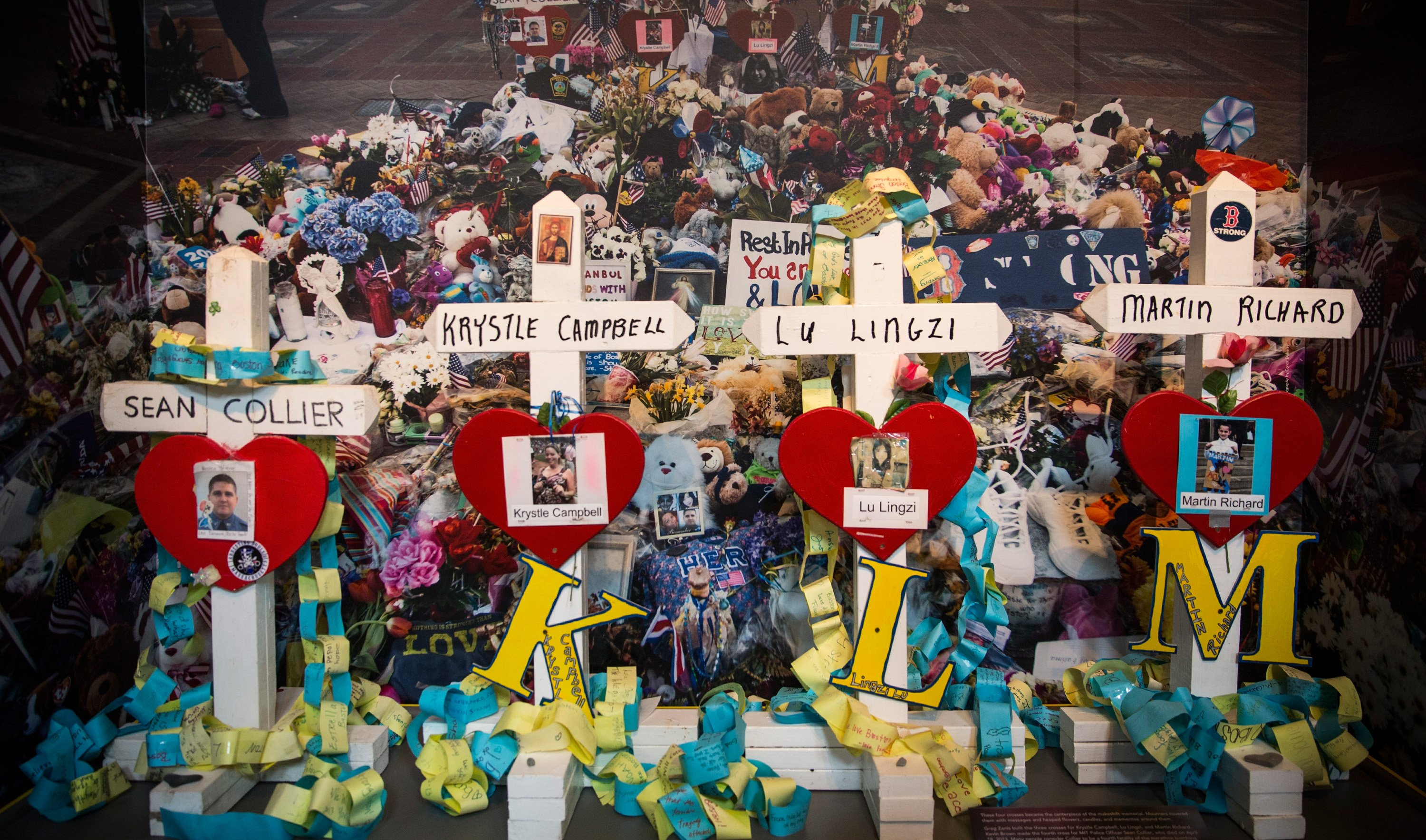 Crosses bearing the names of victims of the 2013 Boston Marathon bombing are displayed in a memorial at the Boston Public Library on April 14, 2014 in Boston.