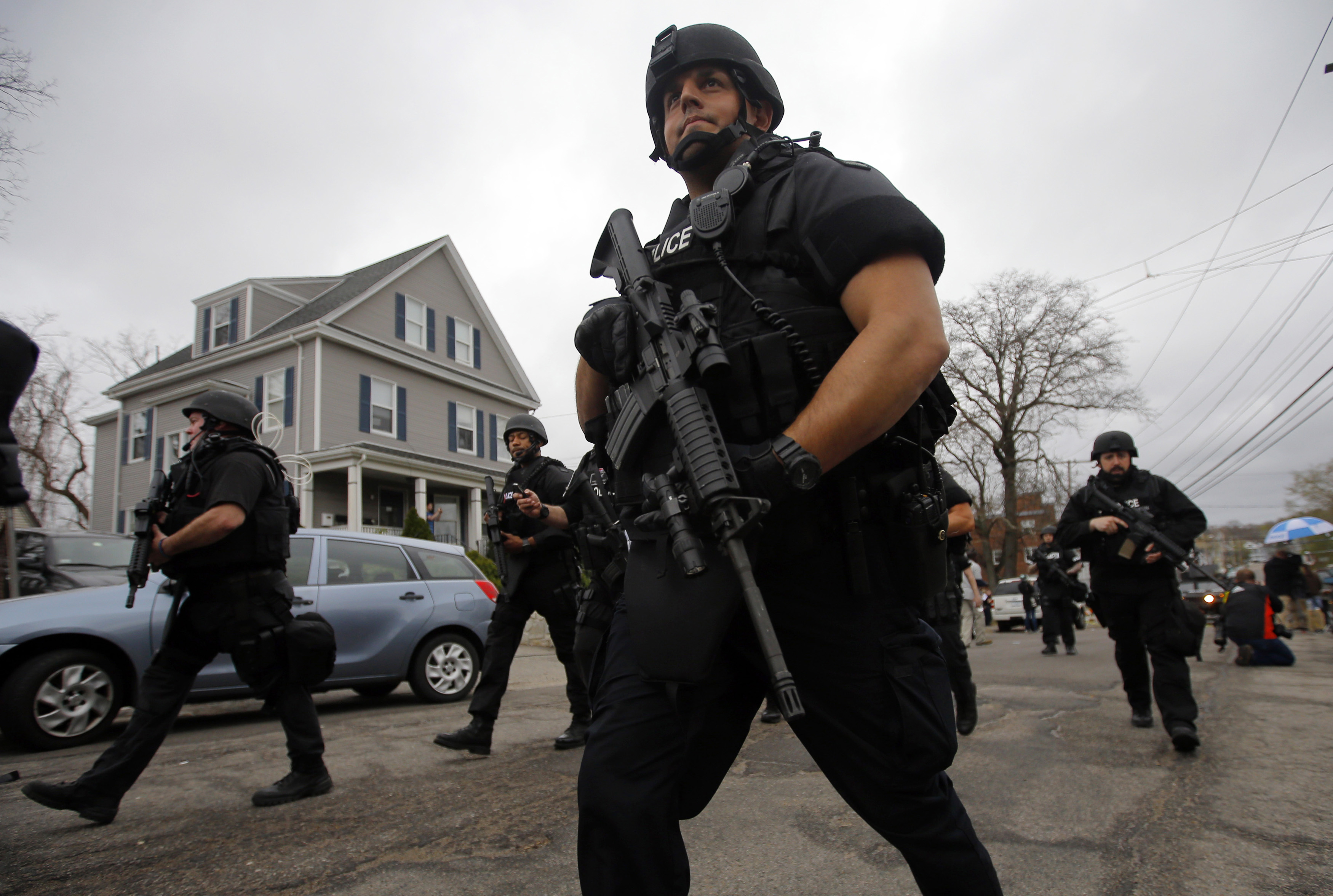 Police officers searched house to house for Dzhokhar Tsarnaev, the surviving suspect in the Boston Marathon bombings, in a neighborhood in Watertown, Mass., on April 19, 2013.