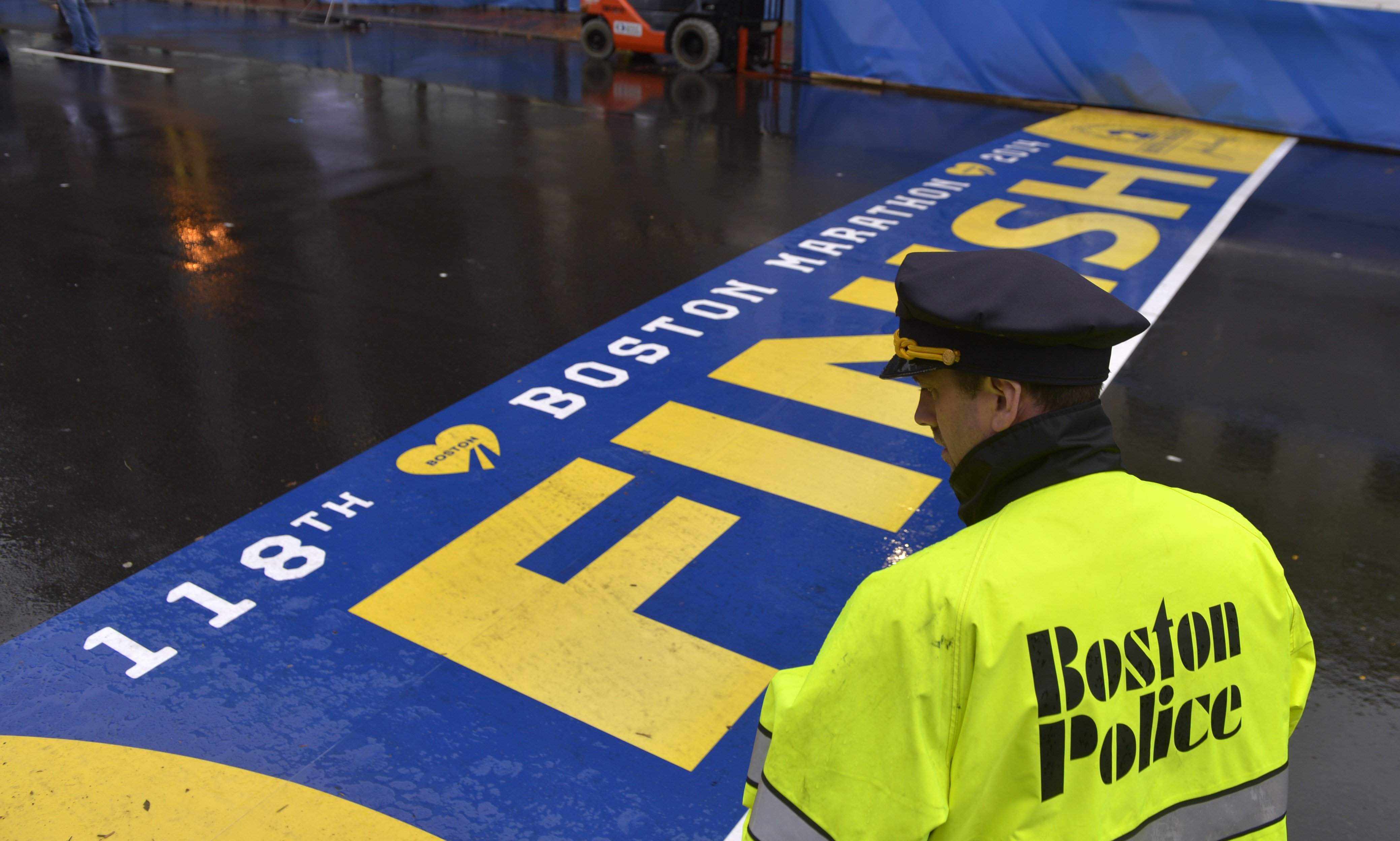 A policeman stands guard during a ceremony commemorating the first anniversary of the Boston Marathon bombings in Boston, on April 15, 2014.
